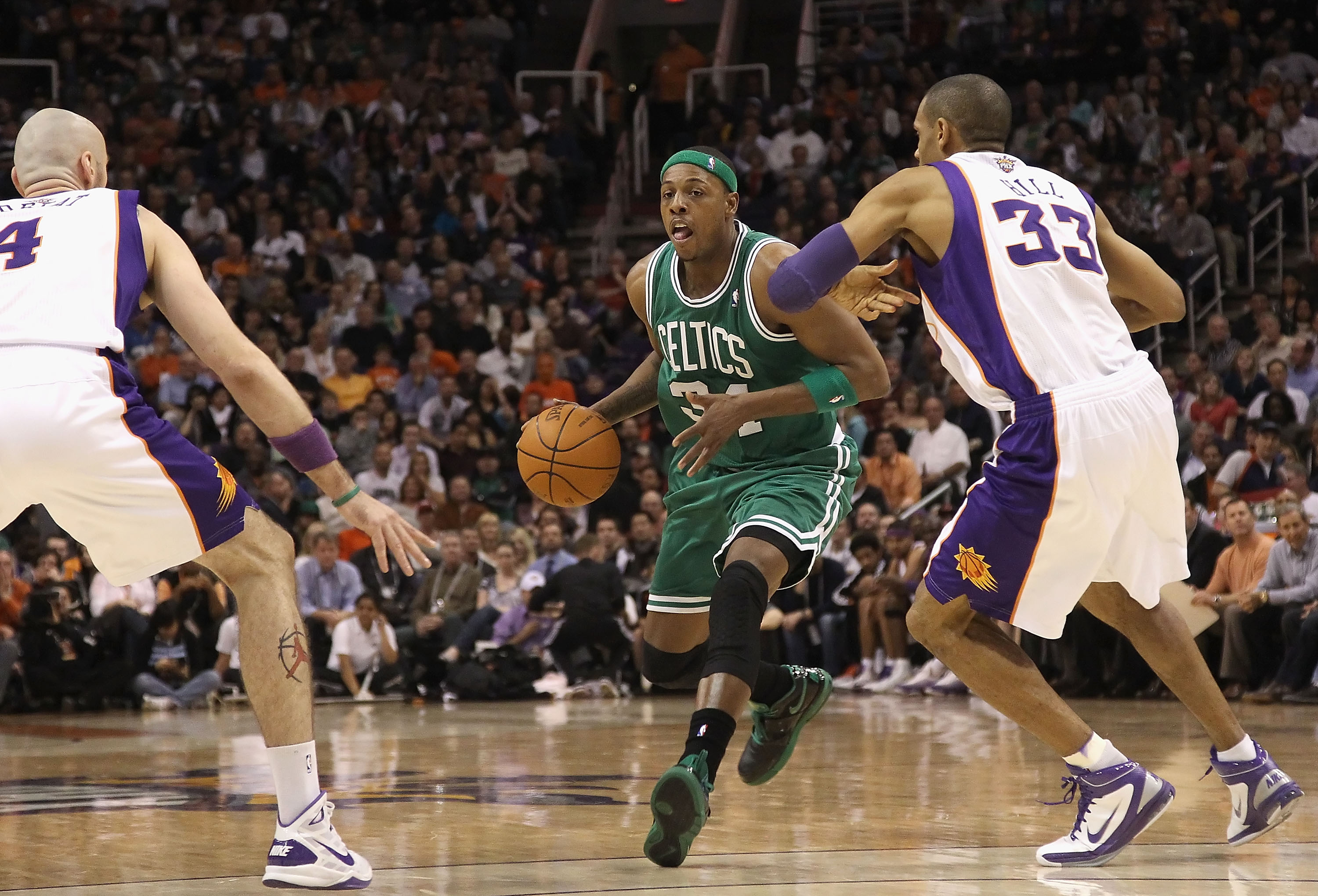 PHOENIX, AZ - JANUARY 28:  Paul Pierce #34 of the Boston Celtics handles the ball during the NBA game against the Phoenix Suns at US Airways Center on January 28, 2011 in Phoenix, Arizona. The Suns defeated the Celtics 88-71. NOTE TO USER: User expressly