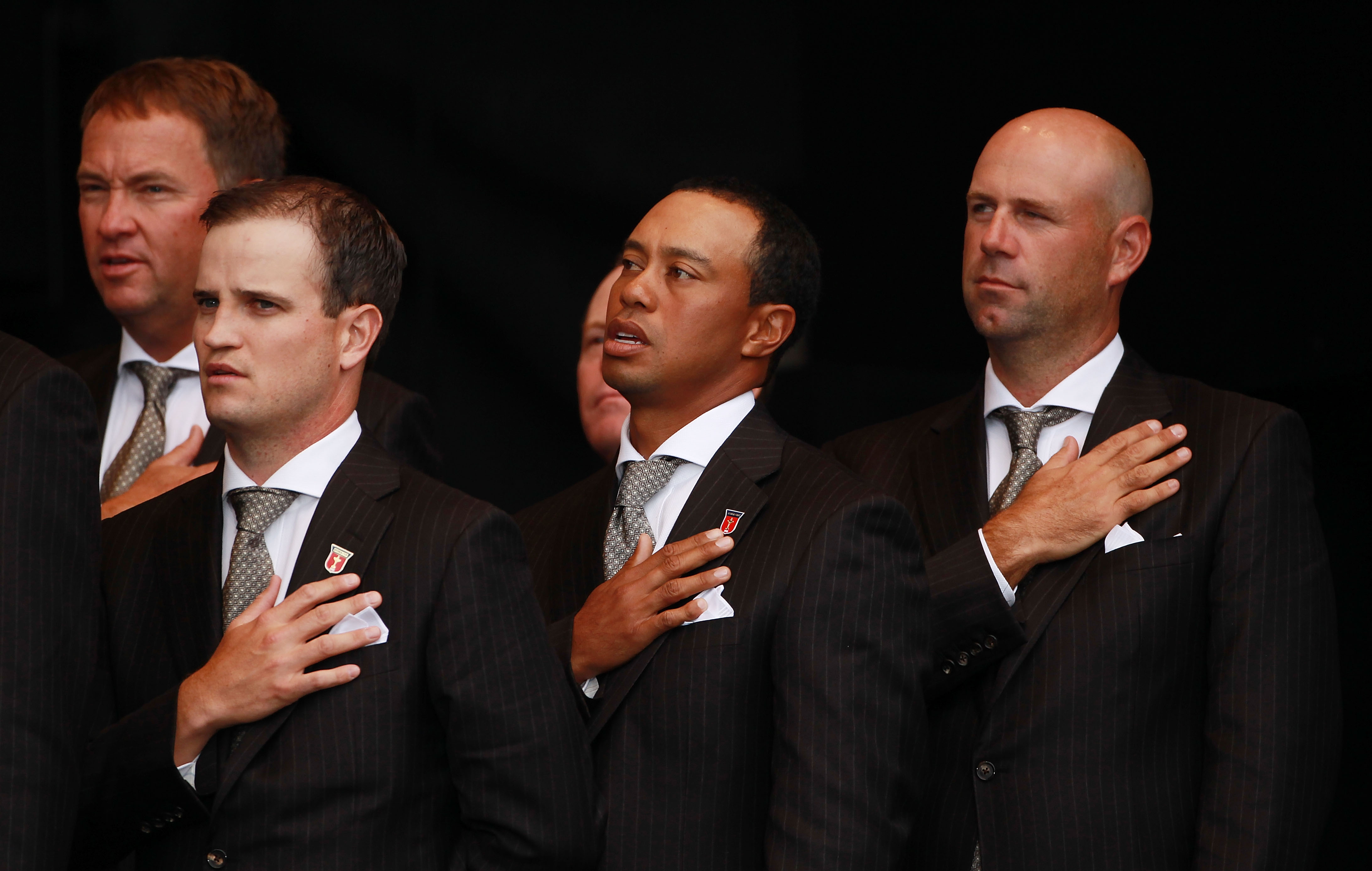 NEWPORT, WALES - SEPTEMBER 30:  Zach Johnson (L) , Tiger Woods and Stewart Cink of the USA (R) stand for their national anthem during the Opening Ceremony prior to the 2010 Ryder Cup at the Celtic Manor Resort on September 30, 2010 in Newport, Wales.  (Ph