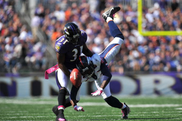 BALTIMORE, MD - OCTOBER 10:  Fabian Washington #31 of the Baltimore Ravens breaks up a pass intended for Brandon Lloyd #84 of the Denver Broncos at M&T Bank Stadium on October 10, 2010 in Baltimore, Maryland. Players wore pink in recognition of Breast Can