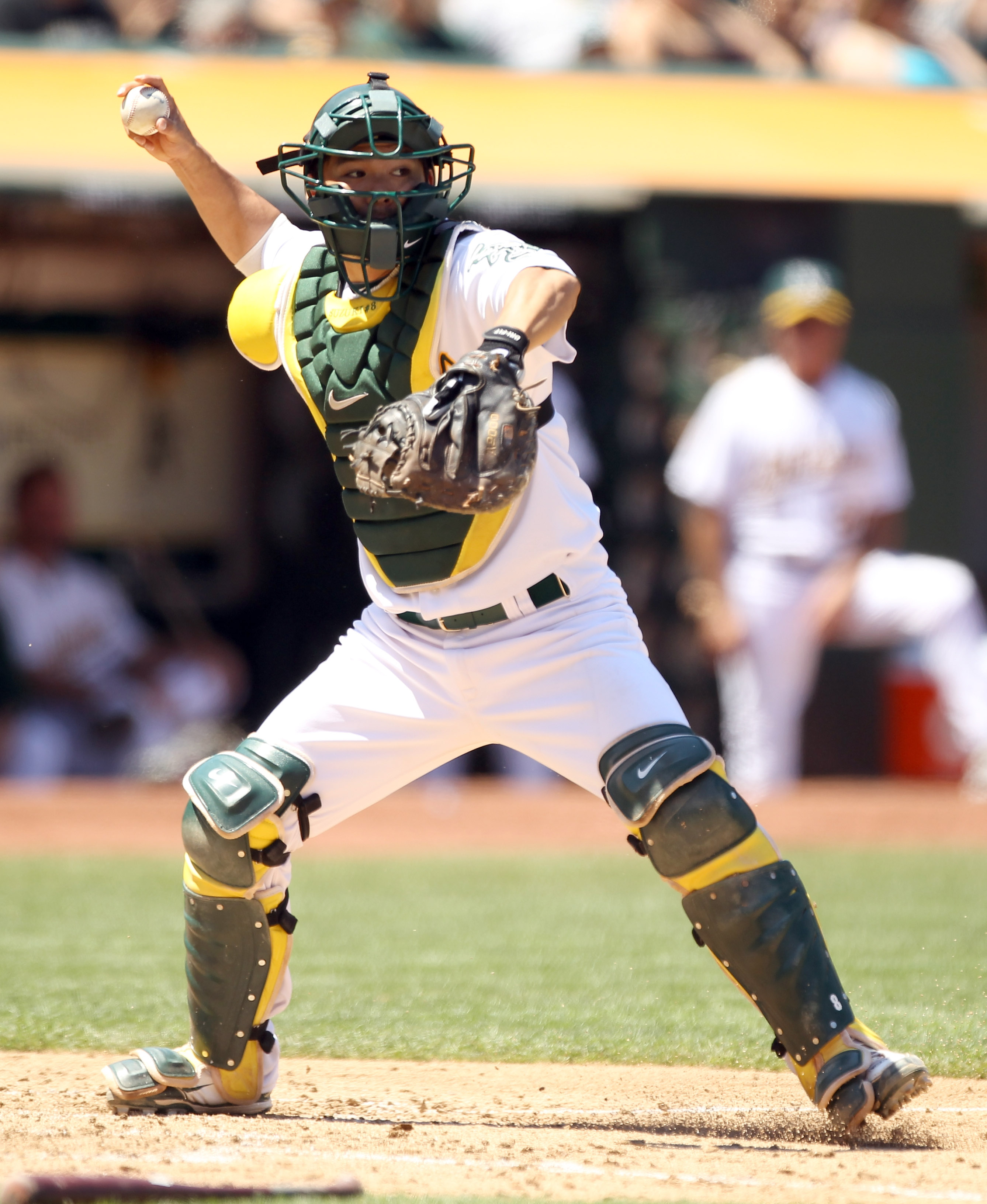 OAKLAND, CA - JULY 11:  Kurt Suzuki #8 of the Oakland Athletics in action against the Los Angeles Angels of Anaheim at the Oakland-Alameda County Coliseum on July 11, 2010 in Oakland, California.  (Photo by Ezra Shaw/Getty Images)
