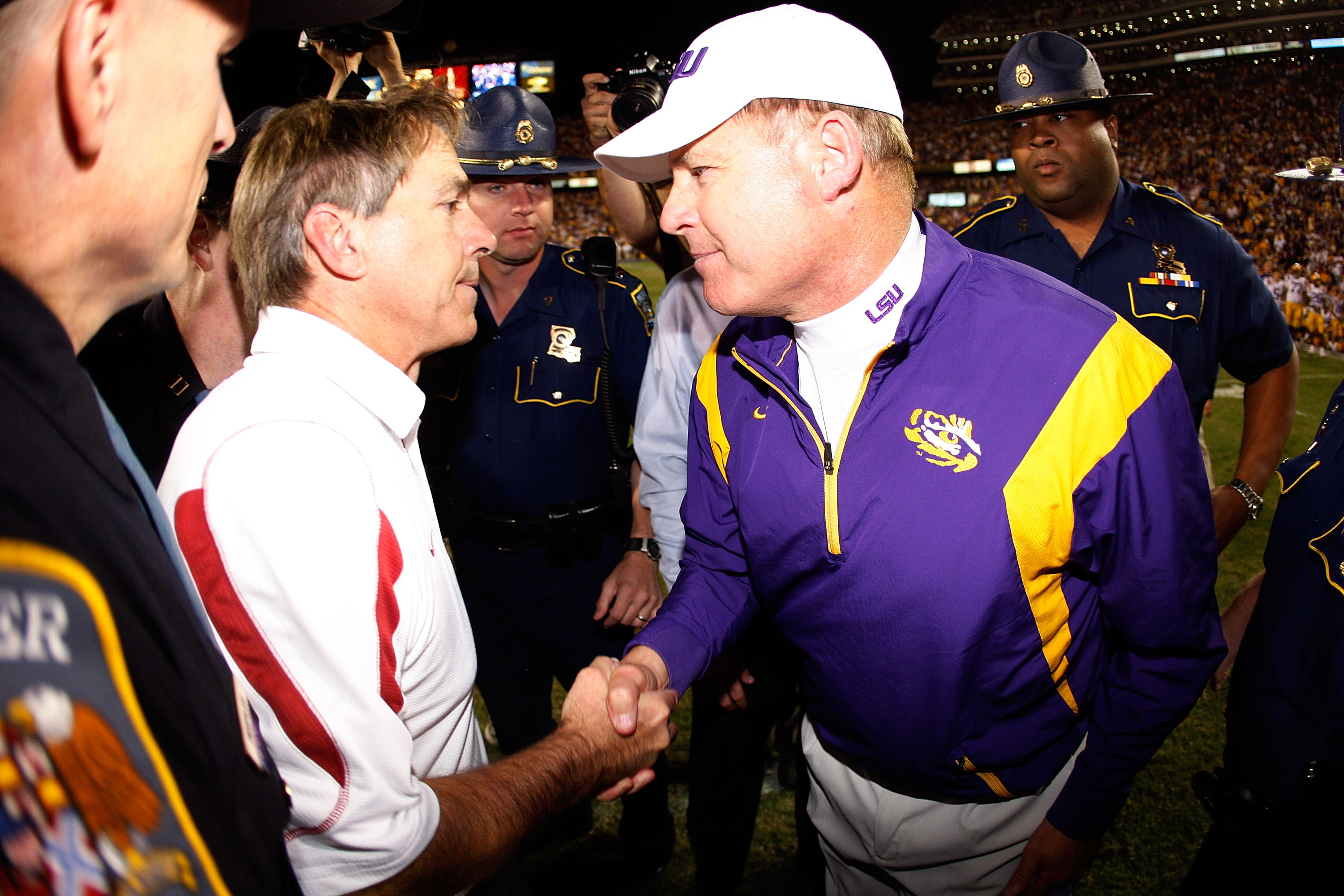BATON ROUGE, LA - NOVEMBER 08:  Head Coach Nick Saban of the Alabama Crimson Tide is congratulated by head coach Les Miles of the Louisiana State University Tigers after the Tide defeated the Tigers 27-21 in overtime on November 11, 2008 at Tiger Stadium