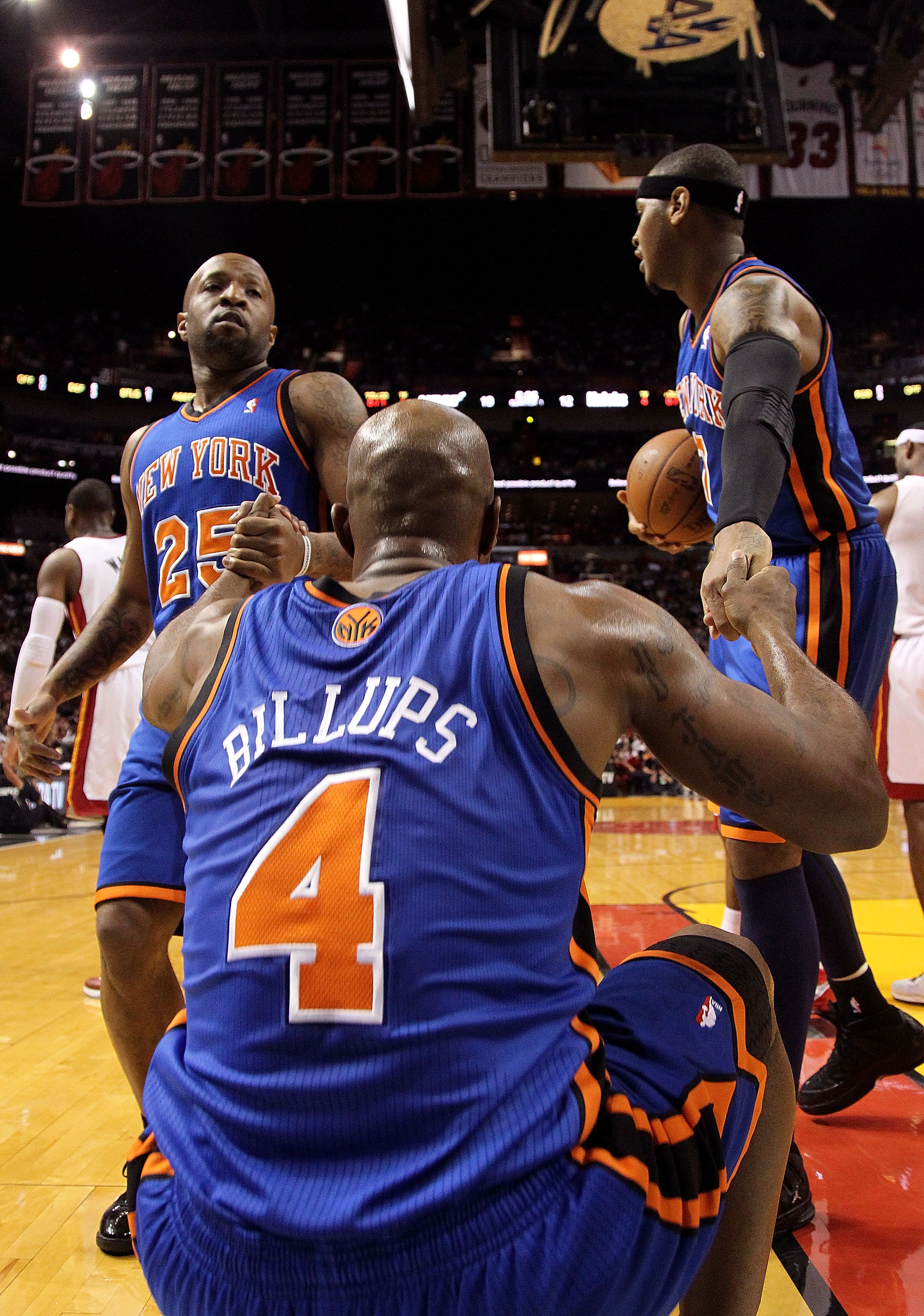 MIAMI, FL - FEBRUARY 27:  Chauncey Billups #4 of the New York Knicks is helped up by Carmelo Anthony #7 and Anthony Carter #25 during a game gainst the Miami Heat at American Airlines Arena on February 27, 2011 in Miami, Florida. NOTE TO USER: User expres