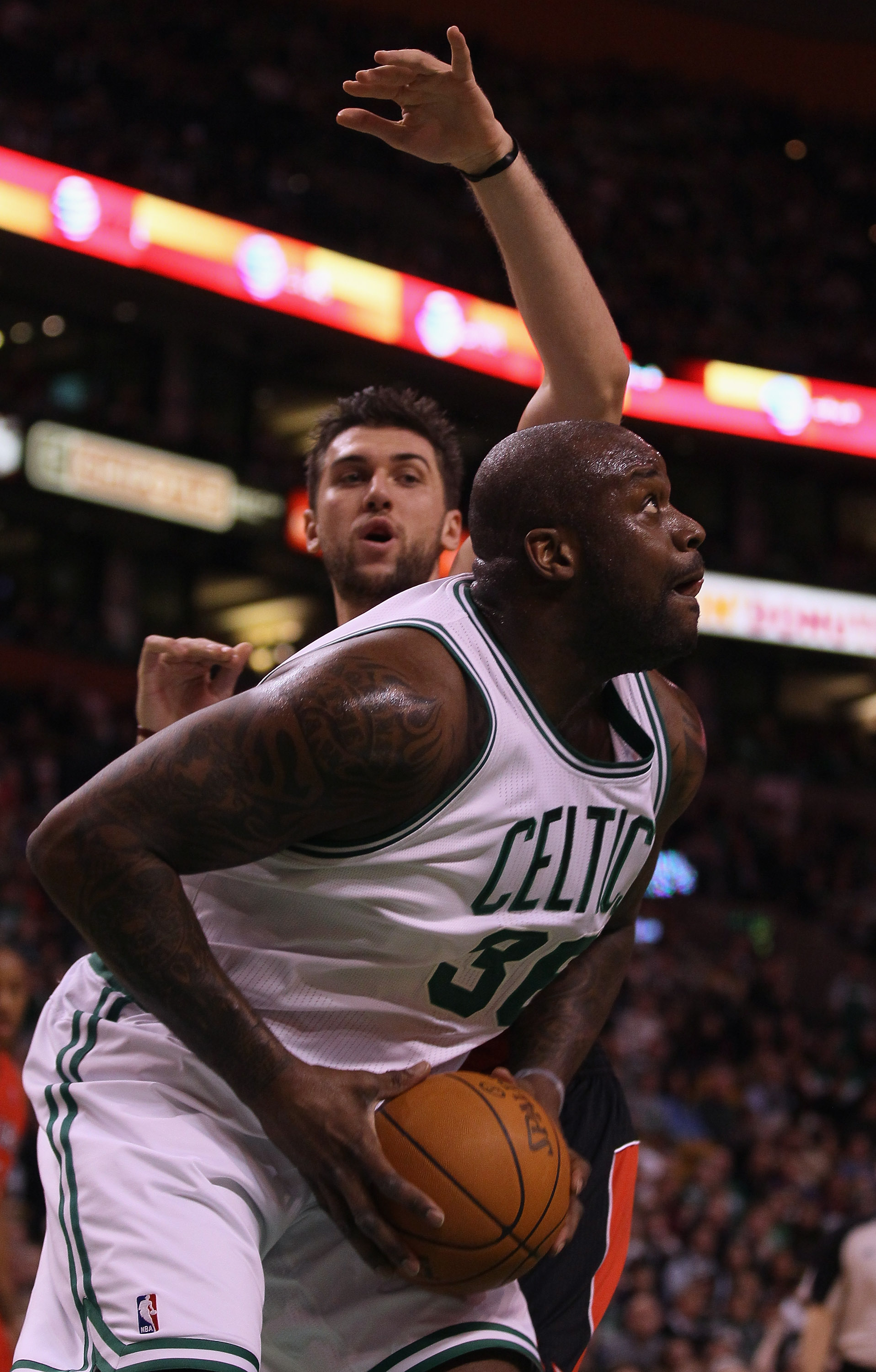 BOSTON, MA - JANUARY 07:  Shaquille O'Neal #36 of the Boston Celtics heads for the basket as Andrea Bargnani #7 of the Toronto Raptors defends on January 7, 2011 at the TD Garden in Boston, Massachusetts. NOTE TO USER: User expressly acknowledges and agre