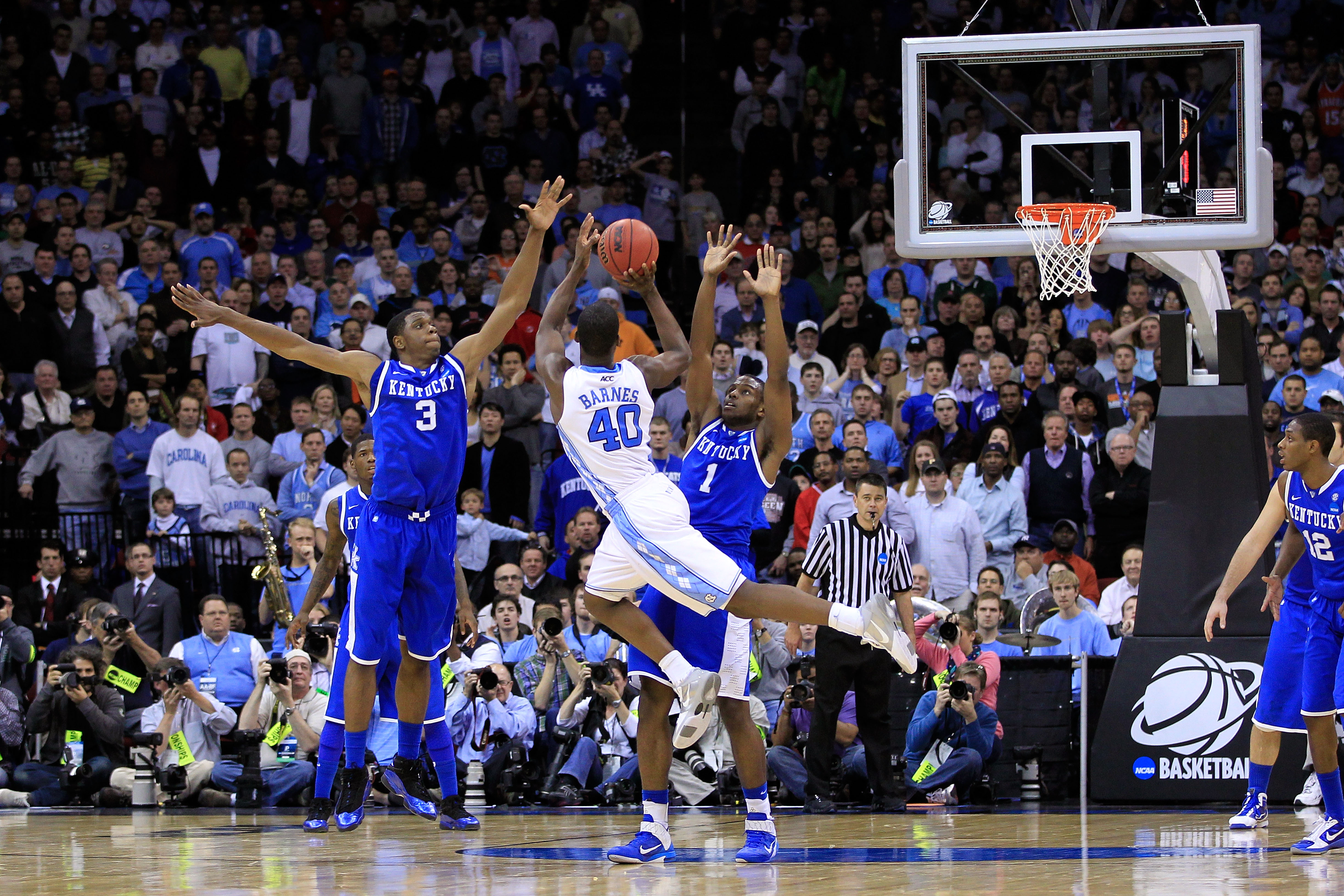 NEWARK, NJ - MARCH 27:  Harrison Barnes #40 of the North Carolina Tar Heels takes a shot against Darius Miller #1 of the Kentucky Wildcats during the east regional final of the 2011 NCAA men's basketball tournament at Prudential Center on March 27, 2011 i