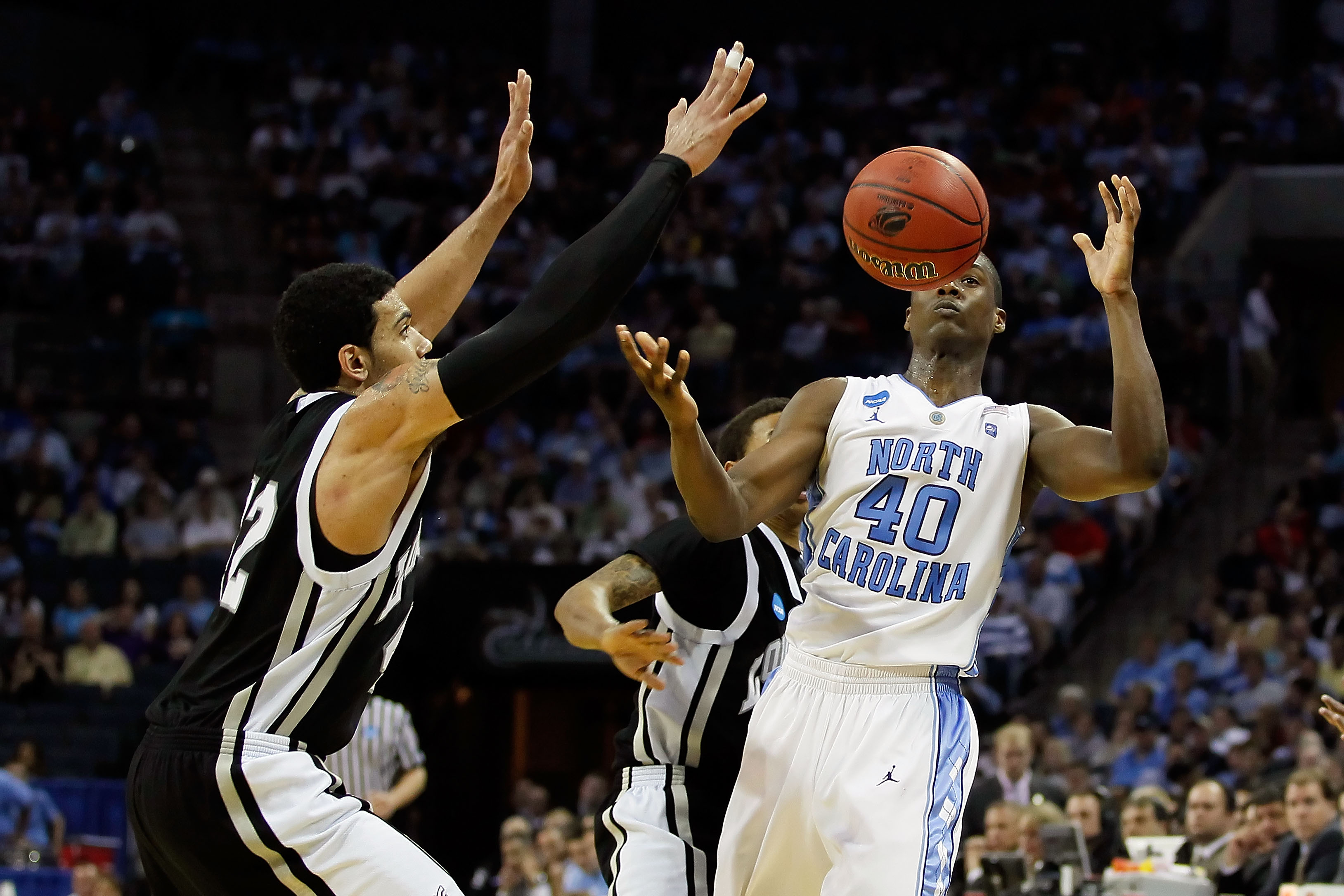 CHARLOTTE, NC - MARCH 18:  Harrison Barnes #40 of the North Carolina Tar Heels looses the ball alongside Julian Boyd #42 of the Long Island Blackbirds in the second half during the second round of the 2011 NCAA men's basketball tournament at Time Warner C