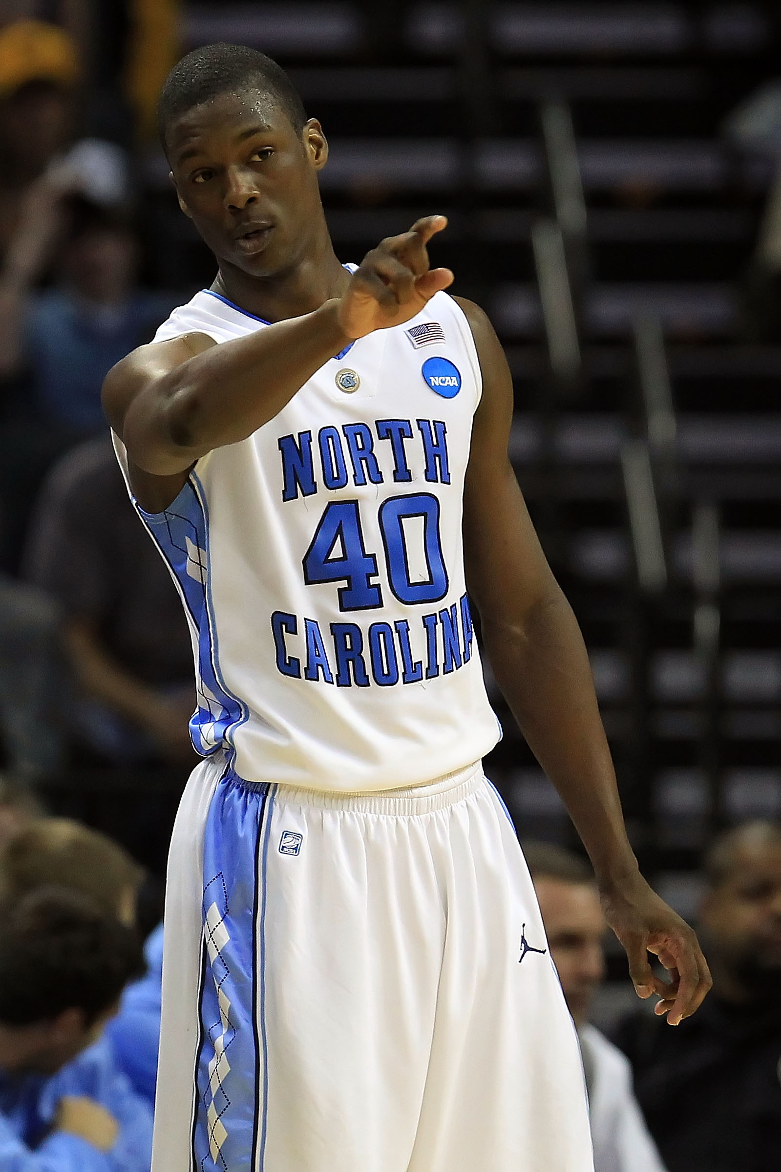 CHARLOTTE, NC - MARCH 20:  Harrison Barnes #40 of the North Carolina Tar Heels points in the second half while taking on the Washington Huskies during the third round of the 2011 NCAA men's basketball tournament at Time Warner Cable Arena on March 20, 201