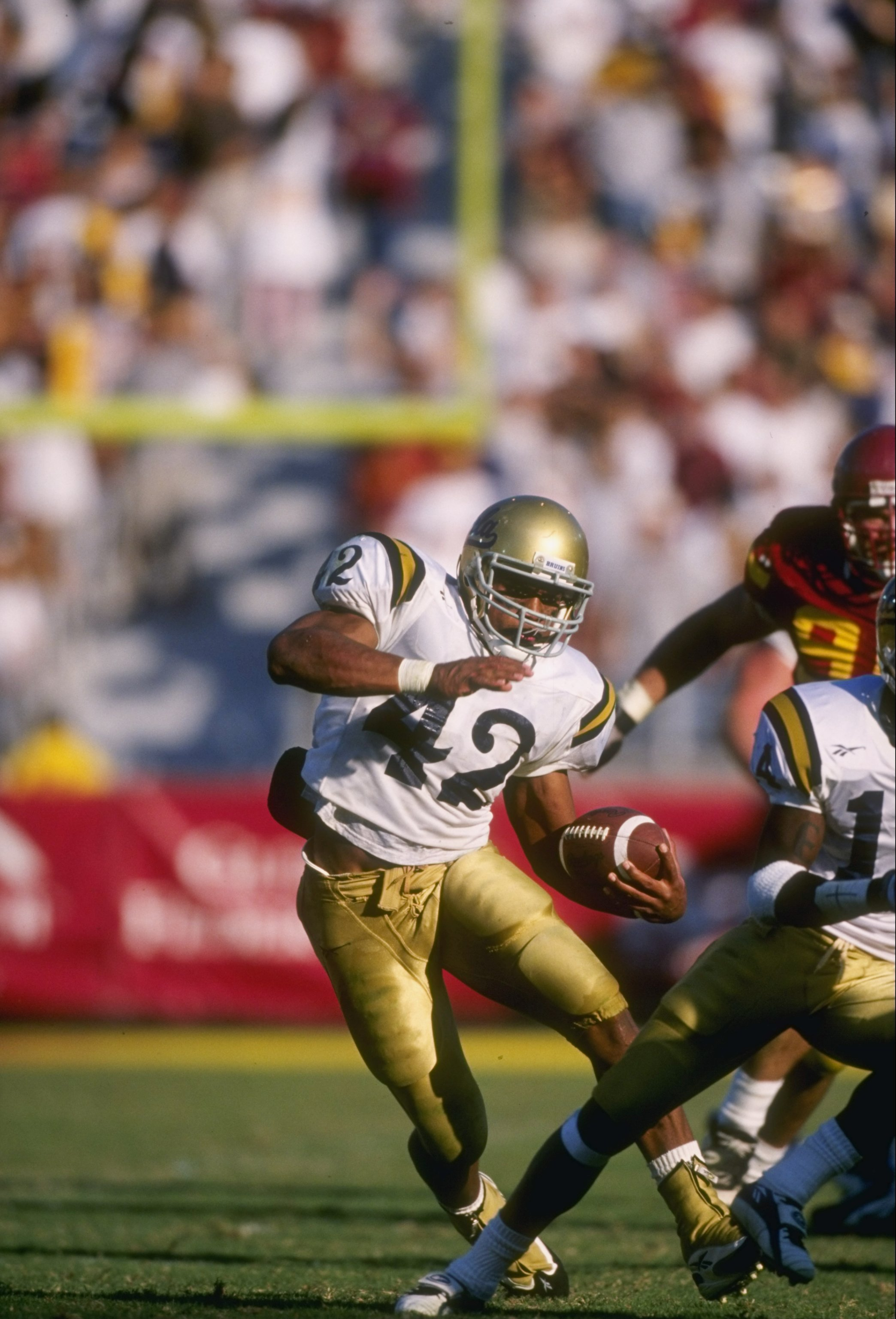 22 Nov 1997:  Tailback Skip Hicks of the UCLA Bruins runs with the ball during a game against the USC Trojans at the Los Angeles Memorial Coliseum in Los Angeles, California.  UCLA won the game 31-24. Mandatory Credit: David Taylor  /Allsport