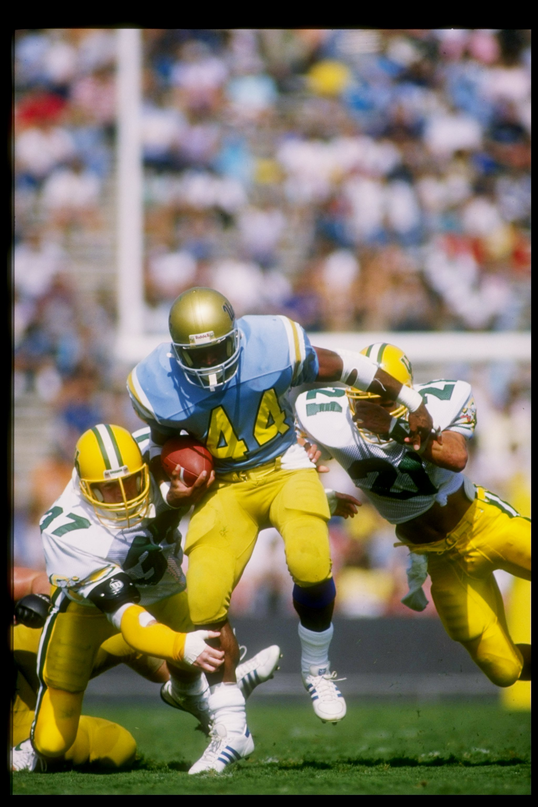 Tailback Gaston Green of the UCLA Bruins tries to break a tackle during a game against the Oregon Ducks at the Rose Bowl in Pasadena, California.