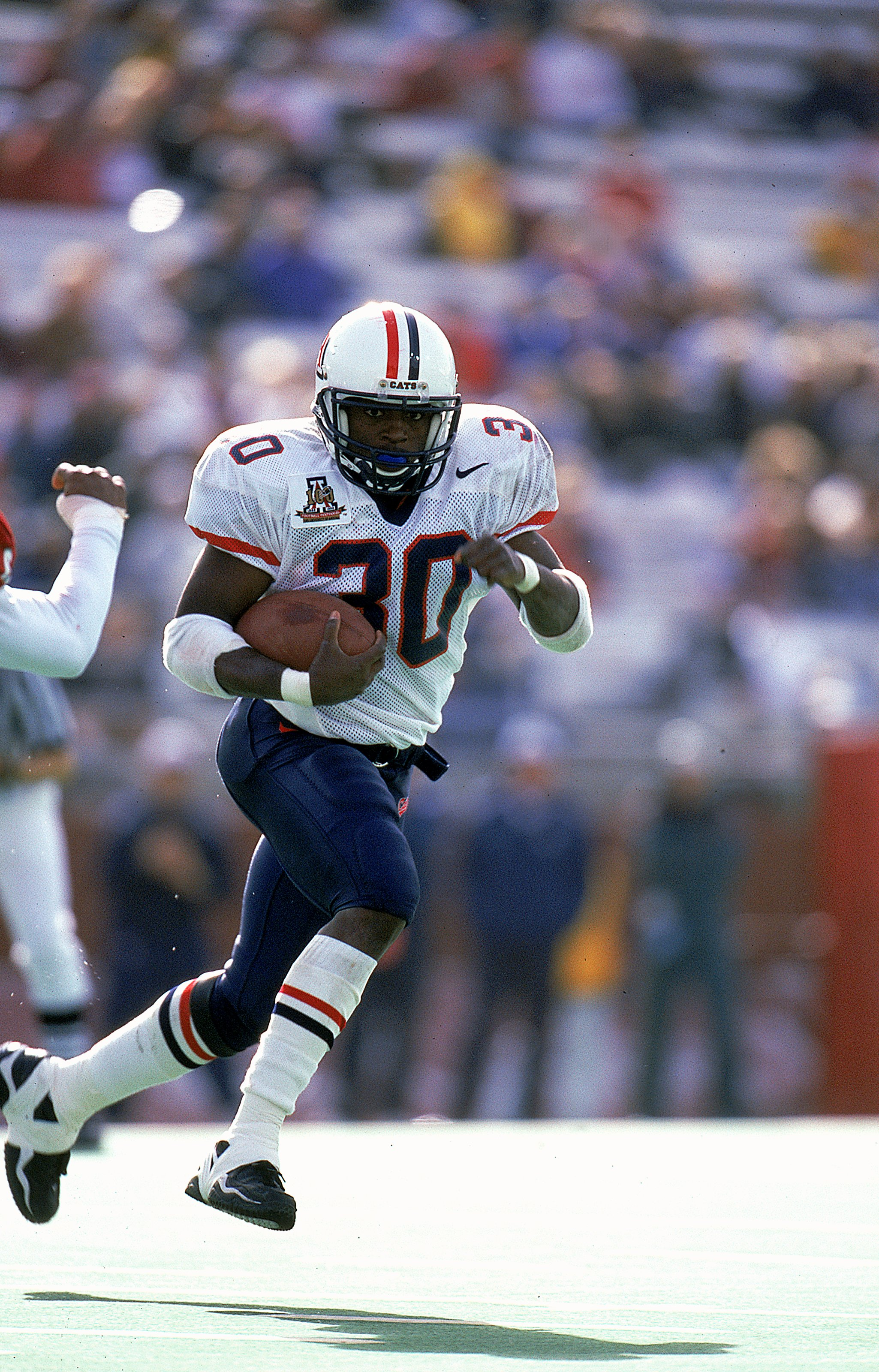 25 Sep 1999: Trung Canidate #30 of the Arizona Wildcats carries the ball during the game against the Washington State Cougars at the Martin Stadium in Pullman, Washington. The Wildcats defeated the Cougars 30-24.
