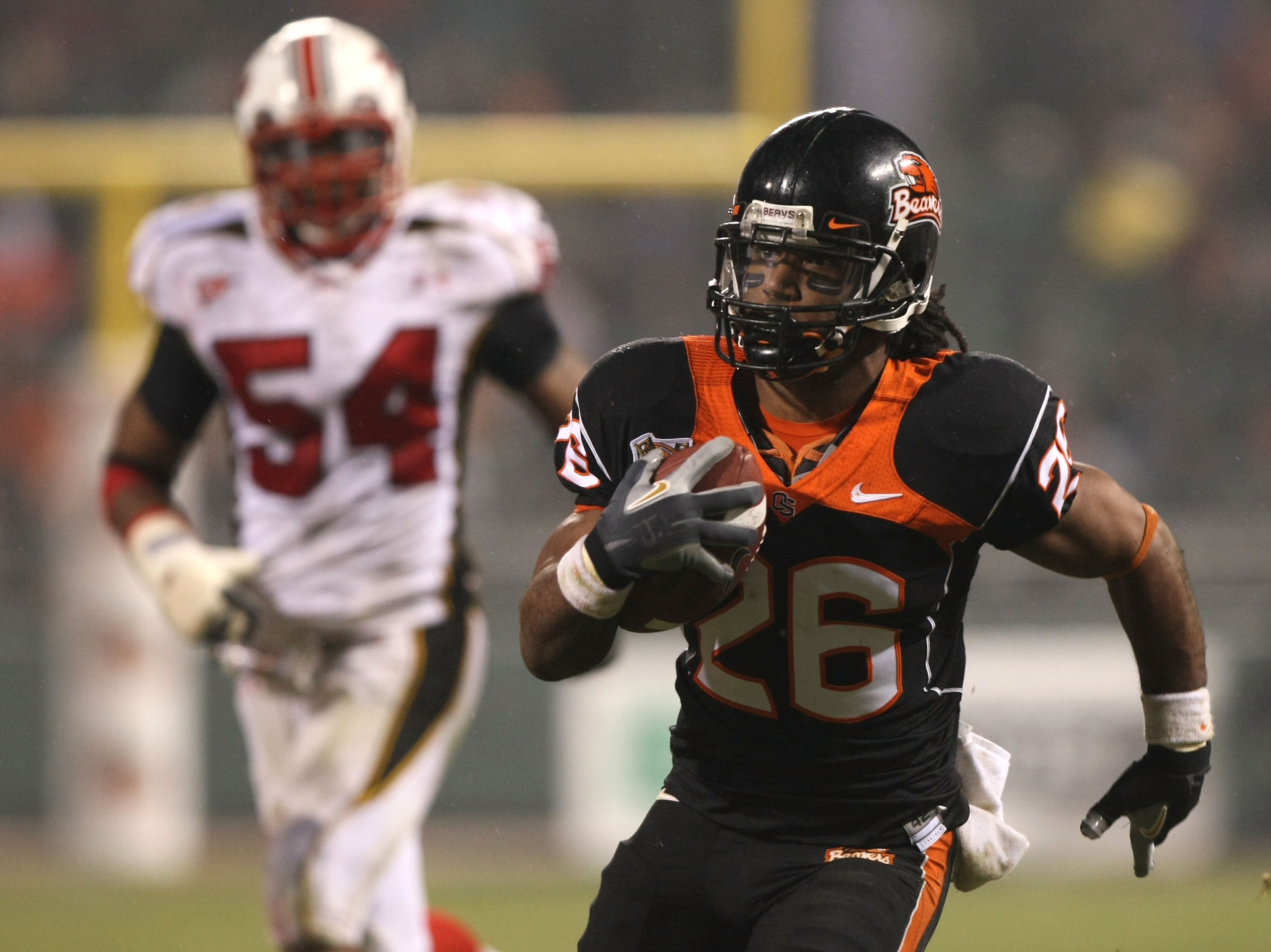 SAN FRANCISCO - DECEMBER 28:  Yvenson Bernard #26 of the Oregon State Beavers runs against the Maryland Terrapins during the Emerald Bowl at AT&T Park December 28, 2007 in San Francisco, California.  (Photo by Jed Jacobsohn/Getty Images)