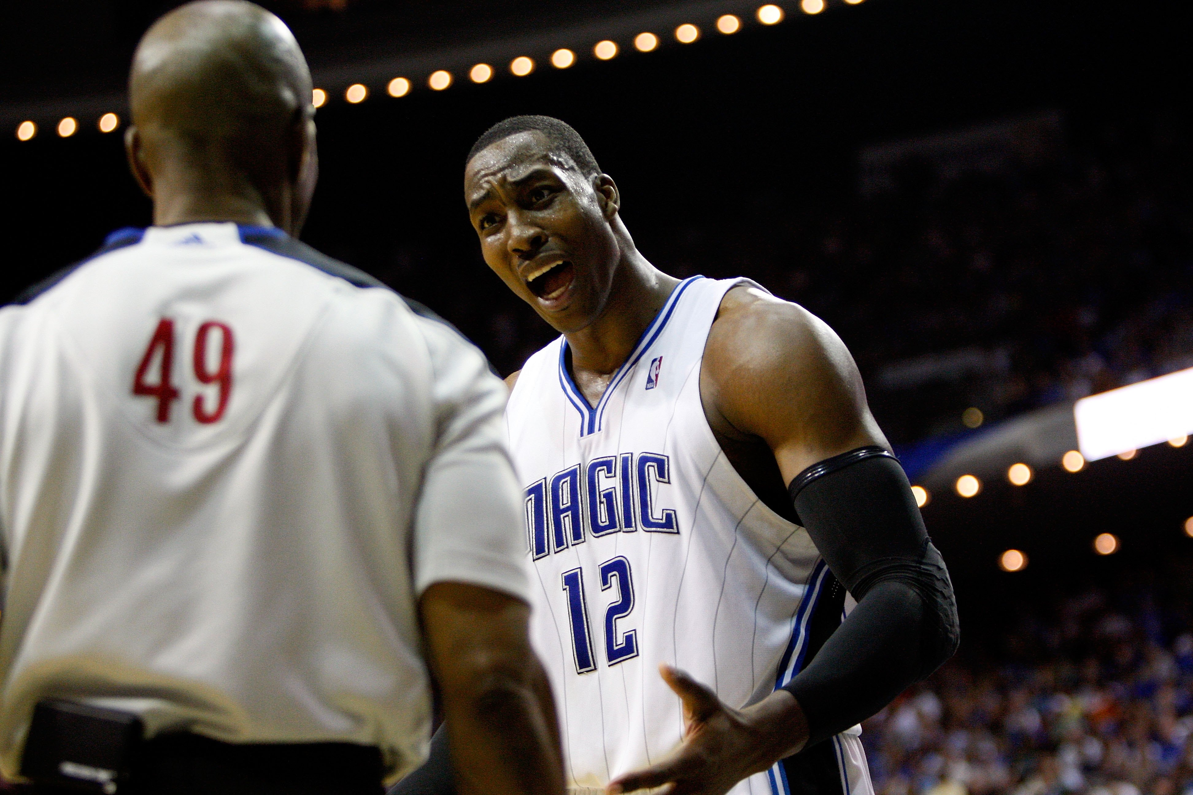 ORLANDO, FL - MAY 26:  Dwight Howard #12 of the Orlando Magic talks with referee Tom Washington against the Boston Celtics in Game Five of the Eastern Conference Finals during the 2010 NBA Playoffs at Amway Arena on May 26, 2010 in Orlando, Florida.  NOTE