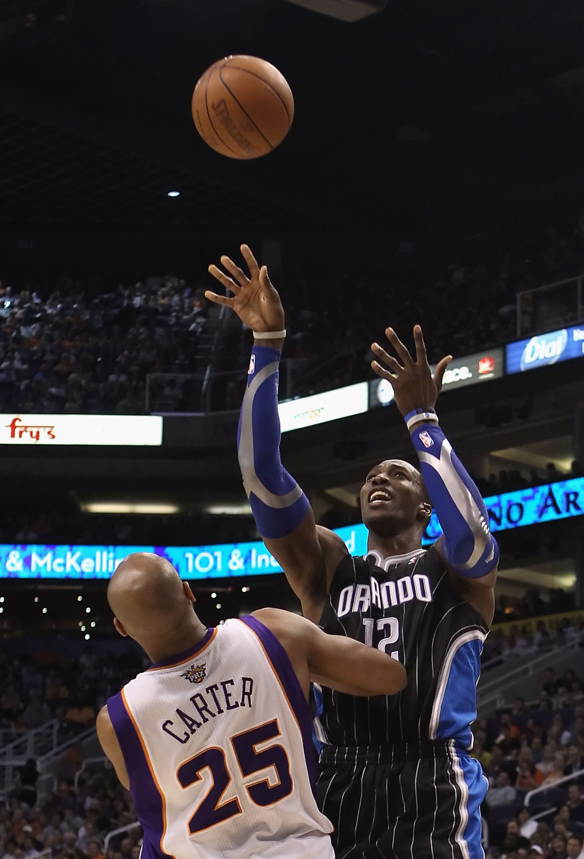 PHOENIX, AZ - MARCH 13:  Dwight Howard #12 of the Orlando Magic puts up a shot against the Phoenix Suns during the NBA game at US Airways Center on March 13, 2011 in Phoenix, Arizona. The Magic defeated the Suns 111-88. NOTE TO USER: User expressly acknow