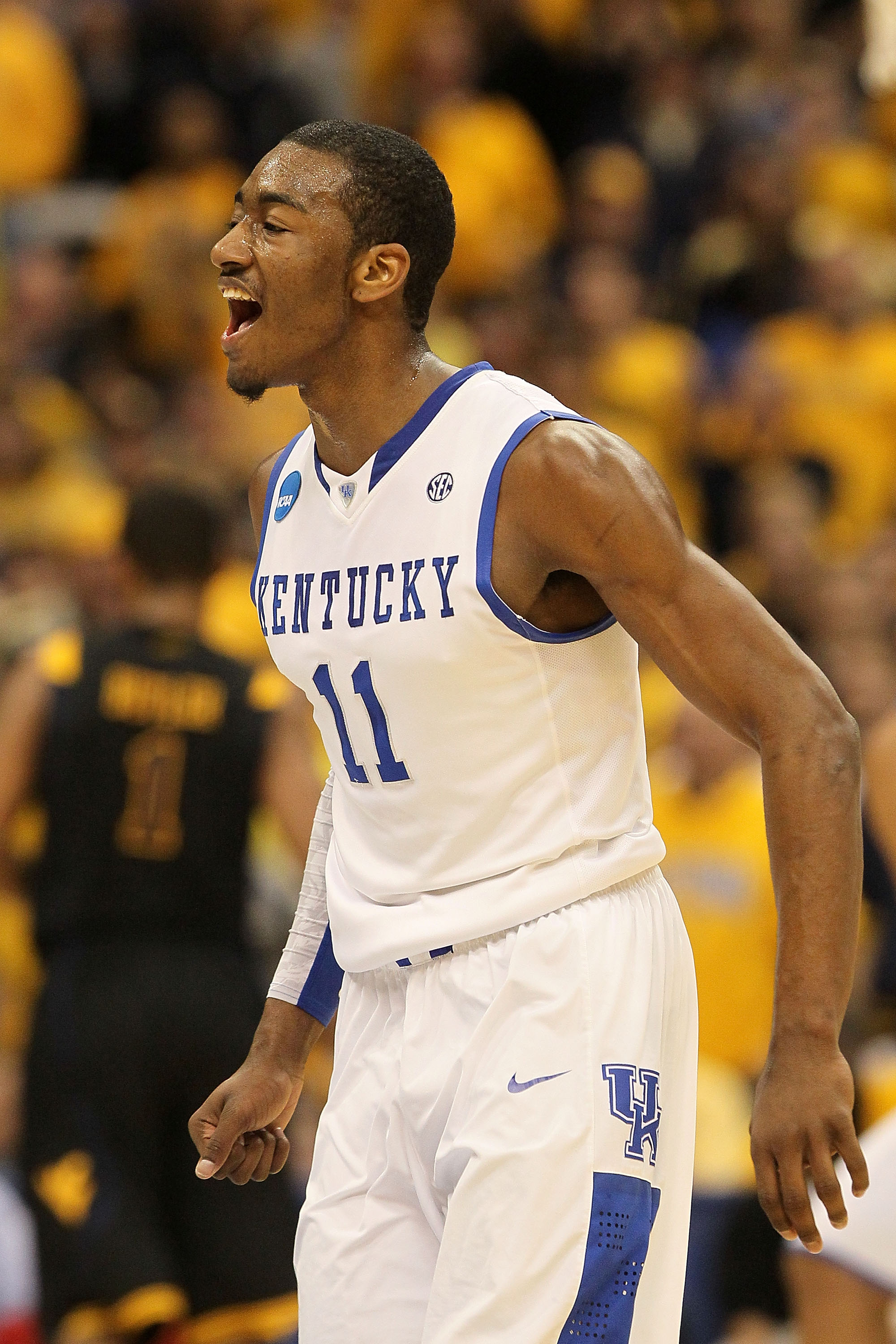 SYRACUSE, NY - MARCH 27:  John Wall #11 of the Kentucky Wildcats reacts against the West Virginia Mountaineers during the east regional final of the 2010 NCAA men's basketball tournament at the Carrier Dome on March 27, 2010 in Syracuse, New York.  (Photo