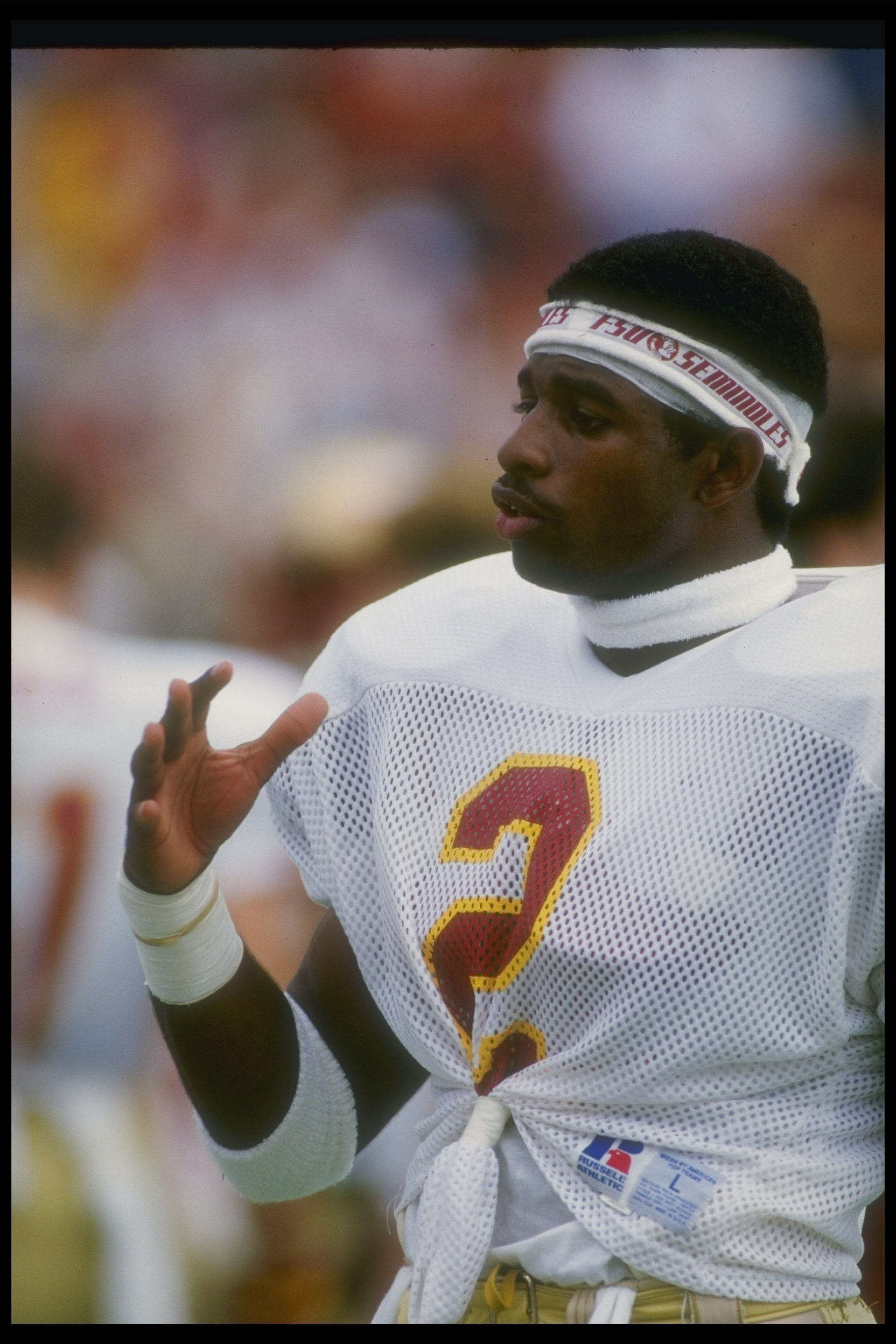1987  Defensive back Deion Sanders of the Florida State Seminoles looks on  during a game ce178d1d4