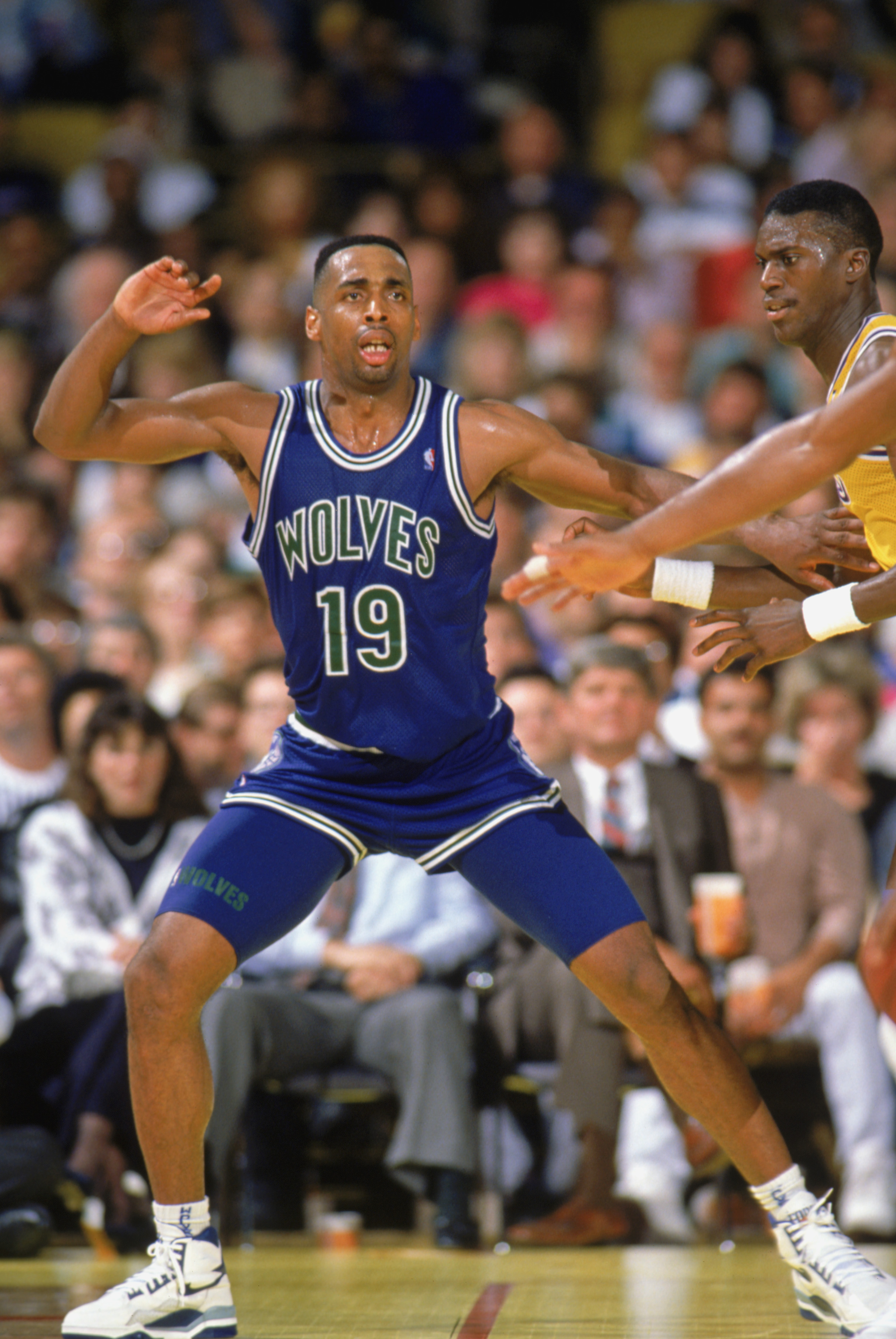 LOS ANGELES - 1990:  Tony Campbell #19 of the Minnesota Timberwolves calls for the ball during a game against the Los Angeles Lakers at the Great Western Forum in Los Angeles, California during the 1989-1990 NBA season.  (Photo by Mike Powell/Getty Images