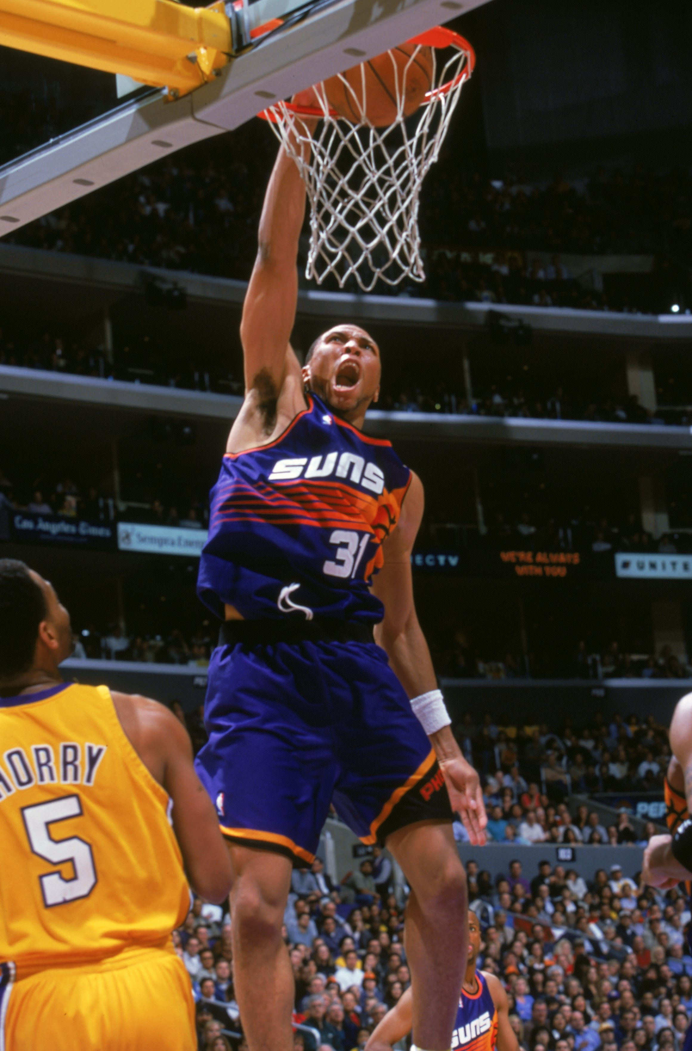 24 Mar 2000: Shawn Marion #31 of the Phoenix Suns makes a slam dunk during a game against the Los Angeles Lakers at the Staples Center in Los Angeles, California. The Lakers defeated the Suns 109-101.       Mandatory Credit: Stephen Dunn  /Allsport
