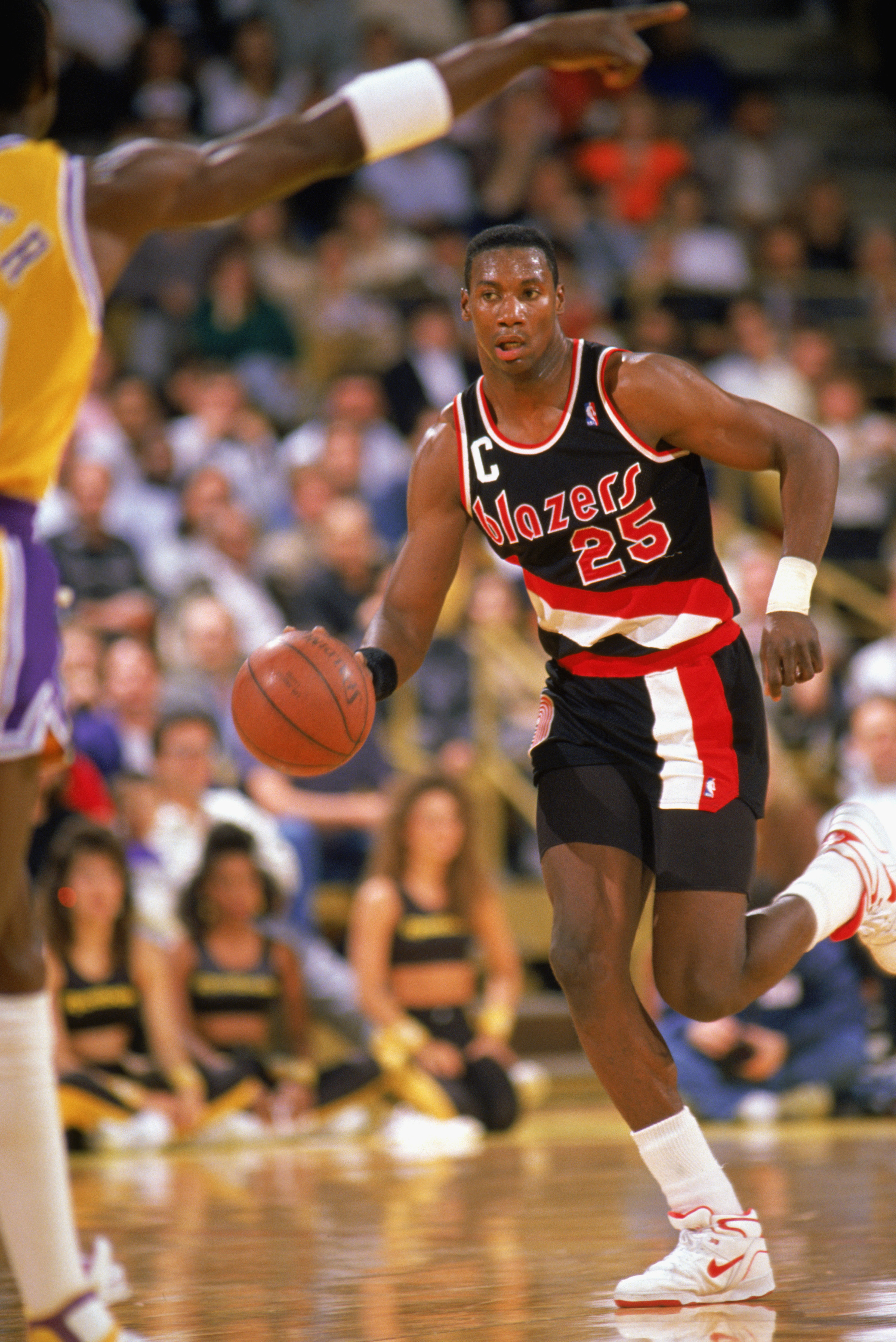 LOS ANGELES - 1988:  Jerome Kersey #25 of the Portland Trail Blazers drives against the Los Angeles Lakers during the 1988-1989 NBA season game at the Great Western Forum in Los Angeles, California.  (Photo by Mike Powell/Getty Images)