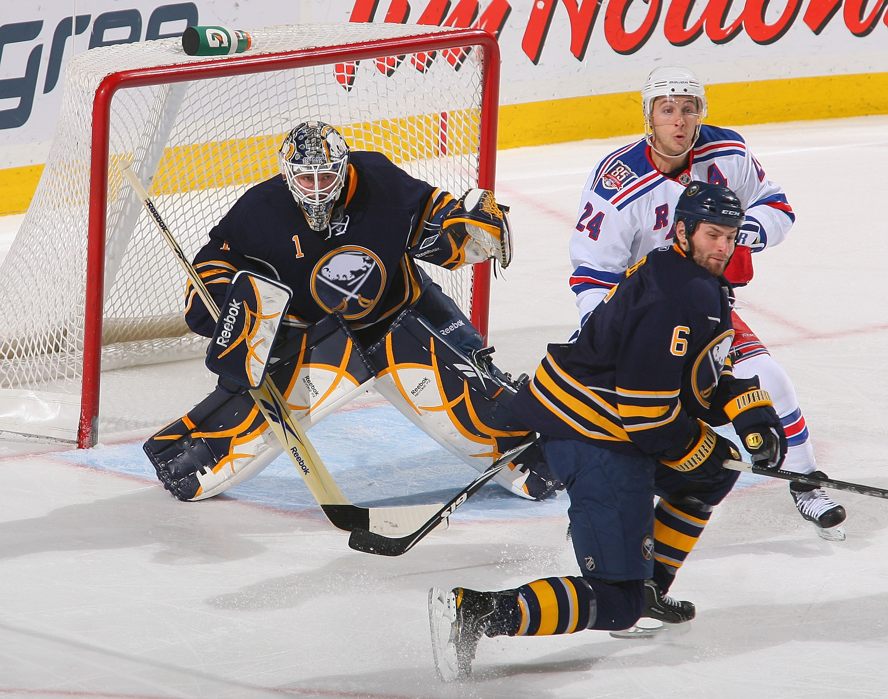 BUFFALO, NY - MARCH 30: Jhonas Enroth #1 and Mike Weber #6  of the Buffalo Sabres defend against Ryan Callahan #24 of the New York Rangers at HSBC Arena on March 30, 2011 in Buffalo, New York.  (Photo by Rick Stewart/Getty Images)