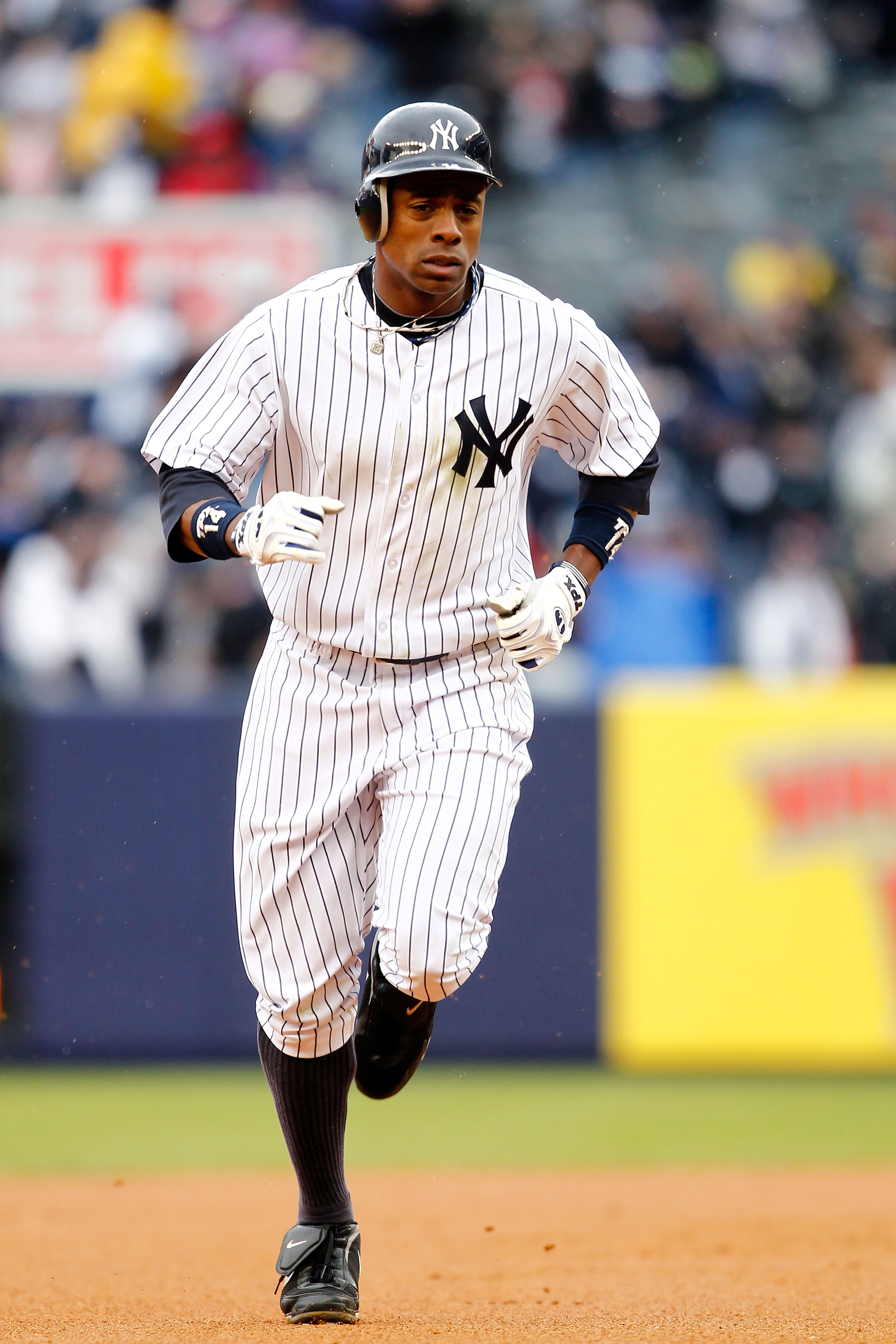 NEW YORK, NY - MARCH 31:  Curtis Granderson #14 of the New York Yankees rounds the bases after hitting a home run to right field in the seventh inning against the Detroit Tigers on Opening Day at Yankee Stadium on March 31, 2011 in the Bronx borough of Ne