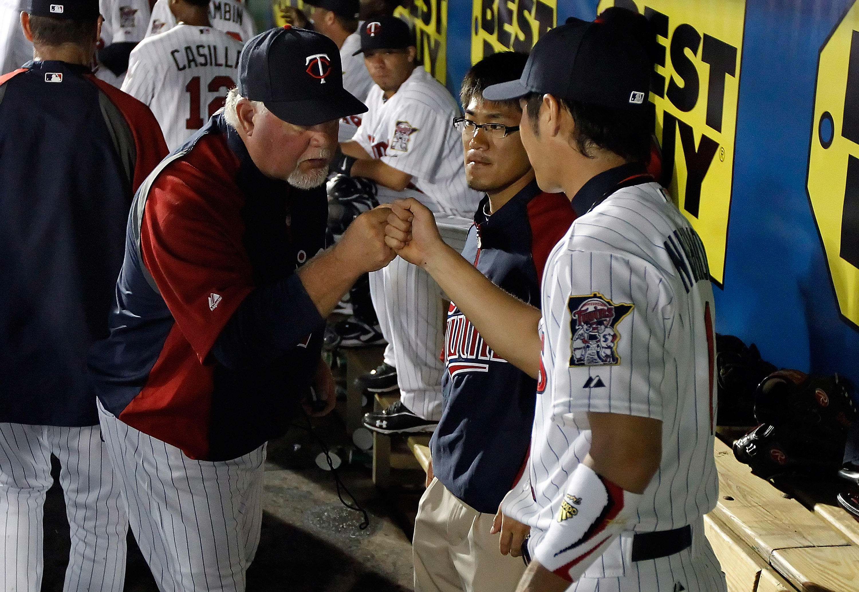 FORT MYERS, FL - FEBRUARY 27:  Manager Ron Gardenhire #35 congratulates infielder Tsuyoshi Nishioka #1 of the Minnesota Twins after making a great play against the Boston Red Sox during a Grapefruit League Spring Training Game at Hammond Stadium on Februa