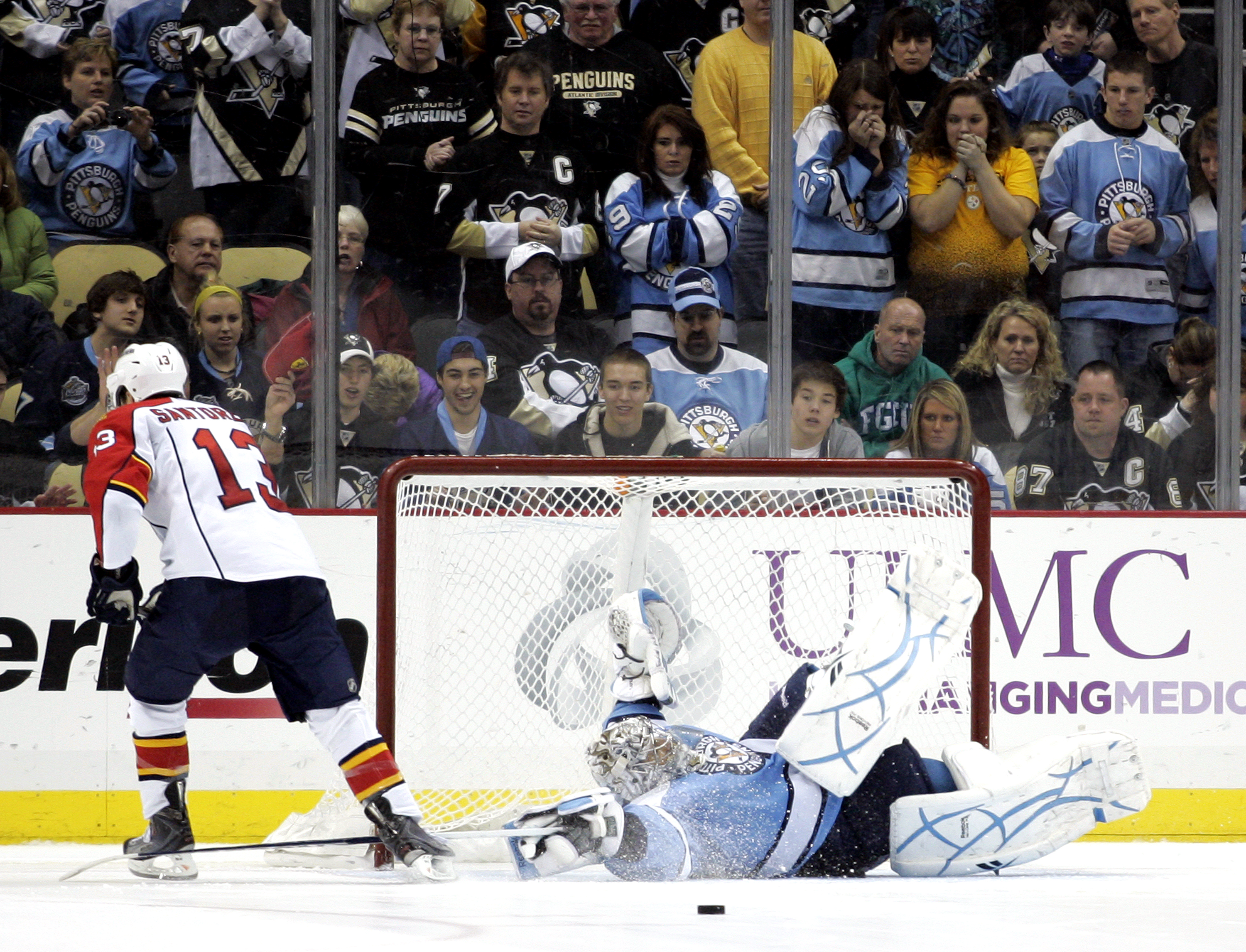 PITTSBURGH, PA - MARCH 27: Marc-Andre Fleury #29 of the Pittsburgh Penguins makes a save against Mike Santorelli #13 of the Florida Panthers during the shootout at Consol Energy Center on March 27, 2011 in Pittsburgh, Pennsylvania. The Penguins defeated t