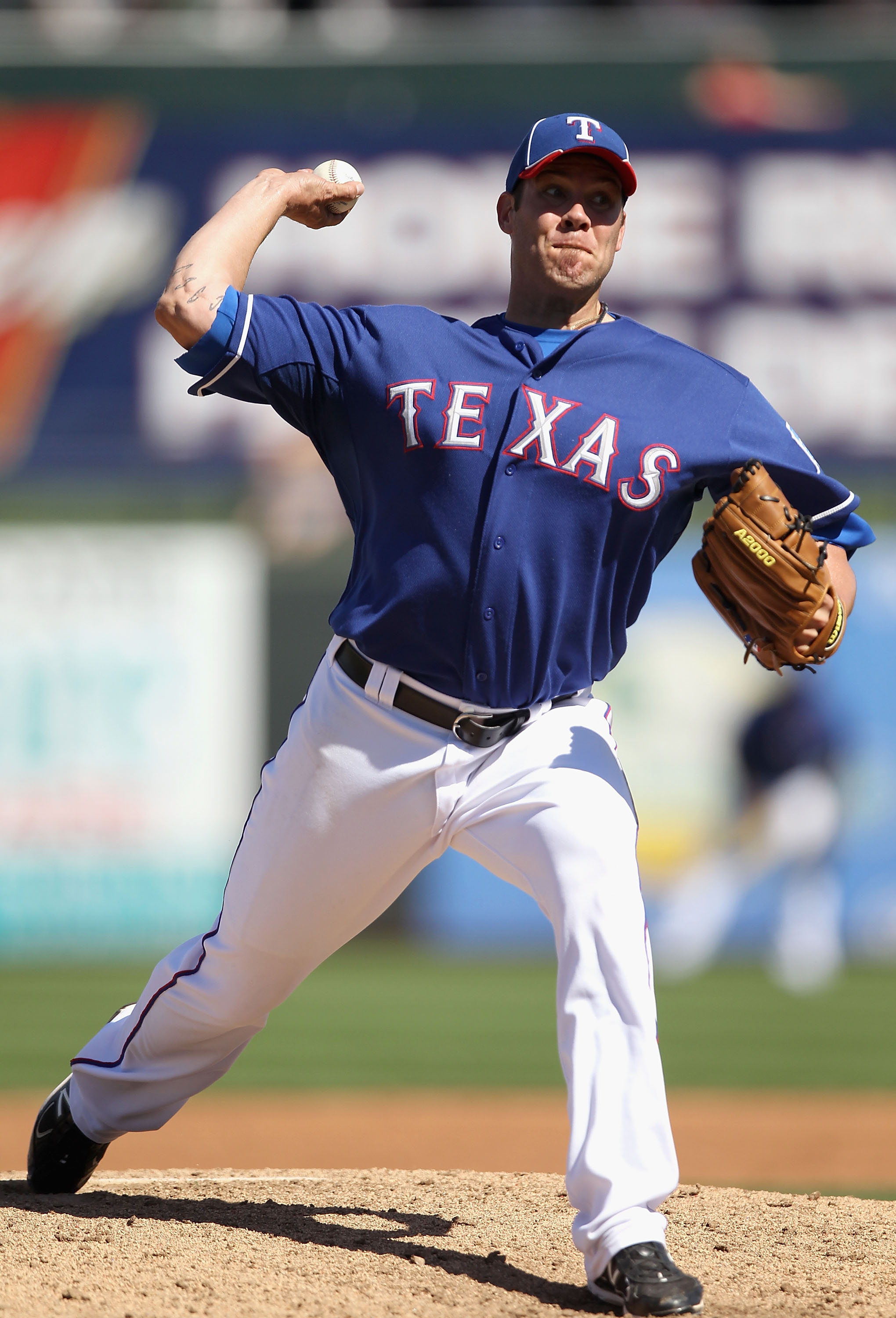 SURPRISE, AZ - MARCH 11:  Starting pitcher Colby Lewis #48 of the Texas Rangers pitches against the Cincinnati Reds during the spring training game at Surprise Stadium on March 11, 2011 in Surprise, Arizona.  (Photo by Christian Petersen/Getty Images)