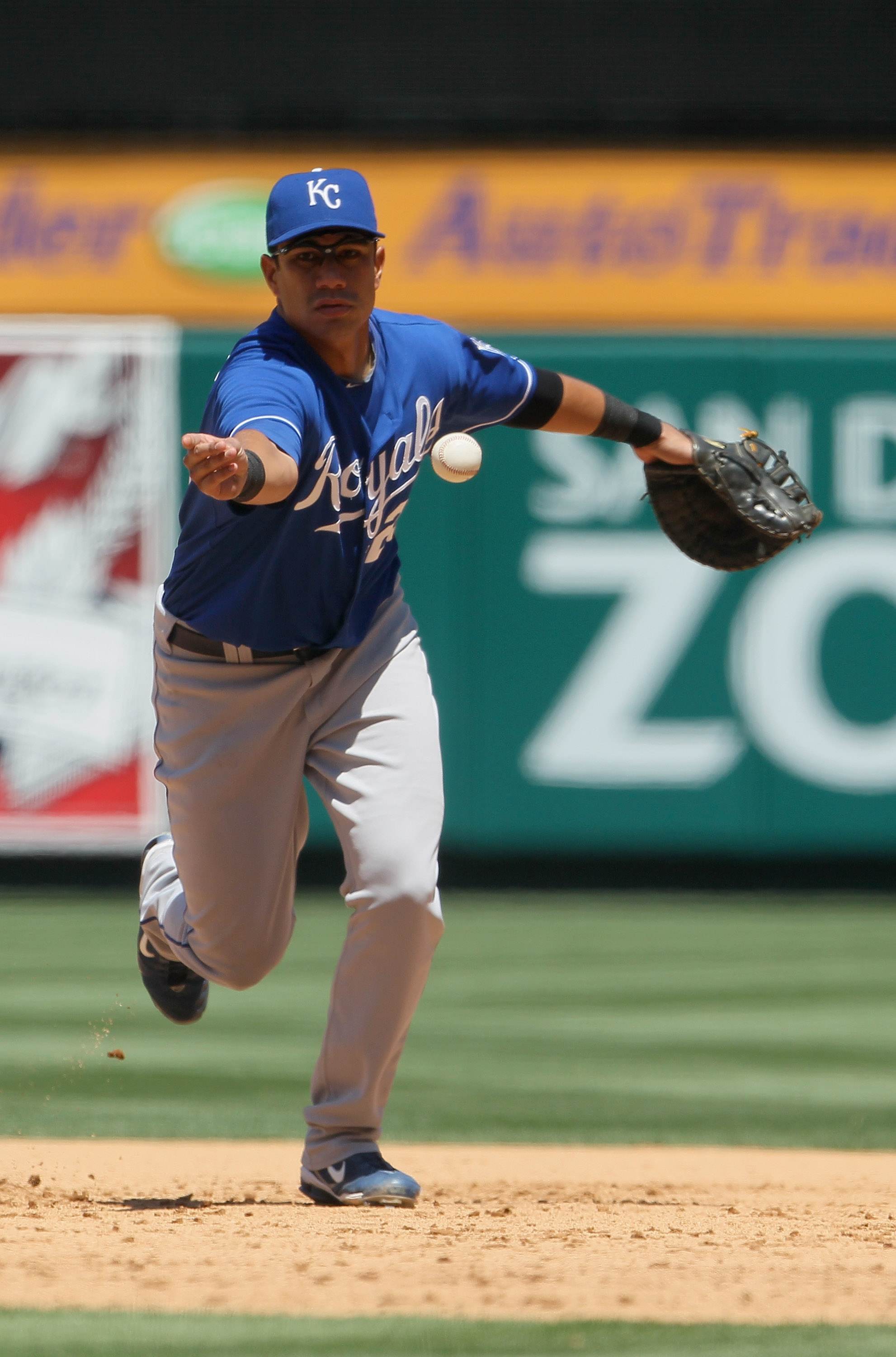 ANAHEIM, CA - AUGUST 11:  Kila Ka'aihue #25 of the Kansas City Royals tosses the ball to first base against the Los Angeles Angels of Anaheim at Angel Stadium on August 11, 2010 in Anaheim, California.  (Photo by Jeff Gross/Getty Images)