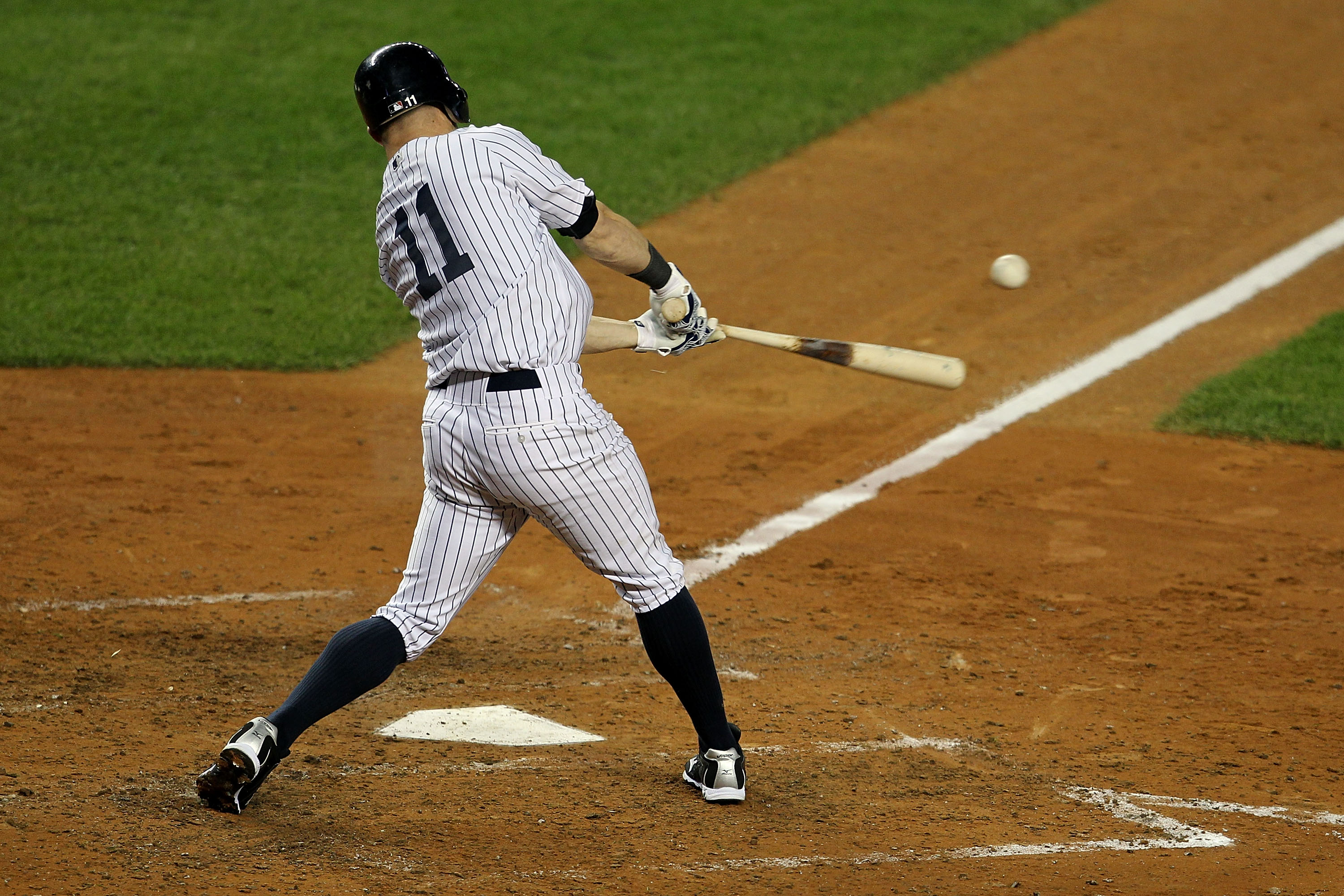 NEW YORK - OCTOBER 19:  Brett Gardner #11 of the New York Yankees breaks his bat while hitting an RBI in the fourth inning against the Texas Rangers in Game Four of the ALCS during the 2010 MLB Playoffs at Yankee Stadium on October 19, 2010 in the Bronx b