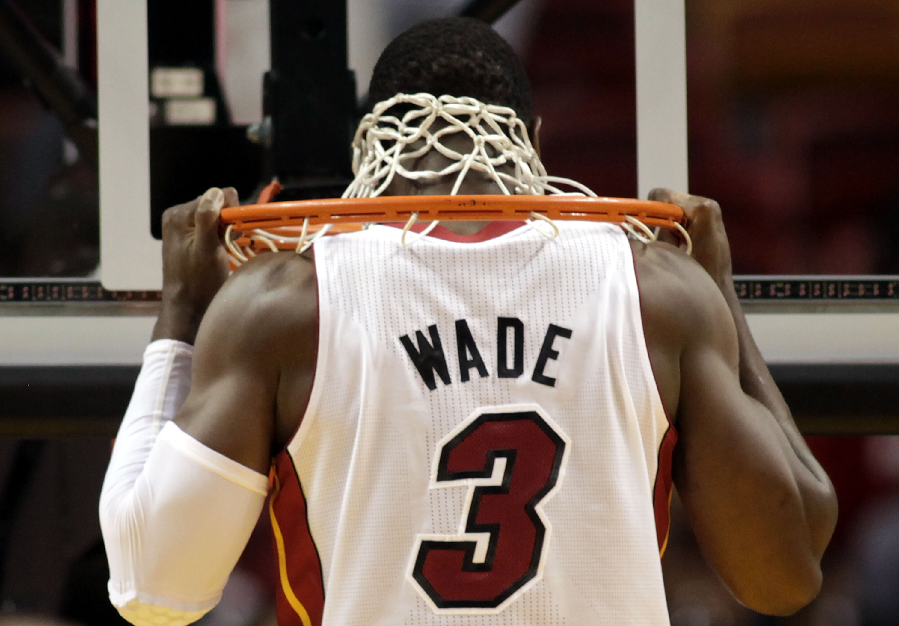MIAMI, FL - MARCH 27:  Guard Dwyane Wade of the Miami Heat stretches against the Houston Rockets at American Airlines Arena on March 27, 2011 in Miami, Florida. NOTE TO USER: User expressly acknowledges and agrees that, by downloading and/or using this Ph