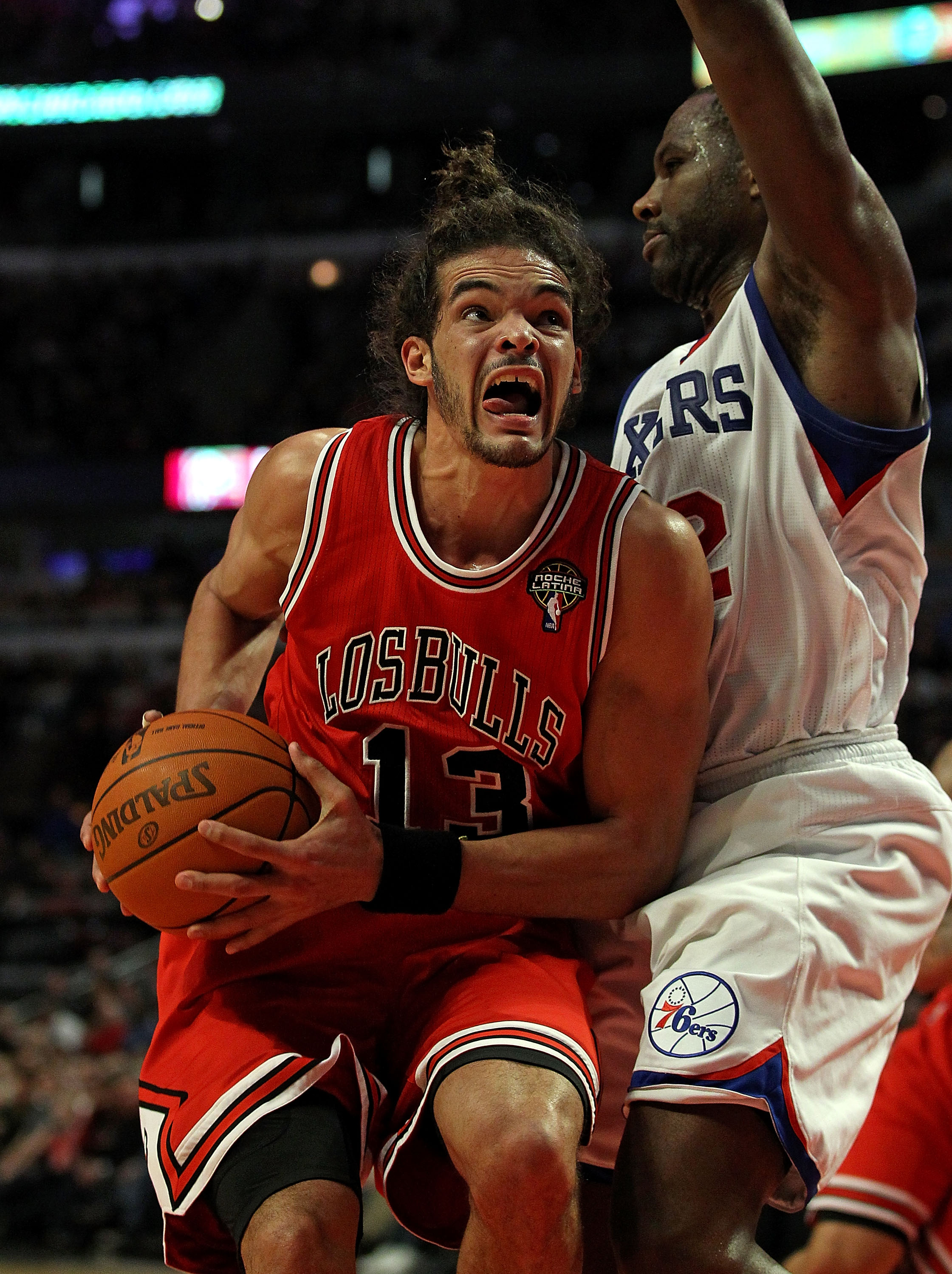 CHICAGO, IL - MARCH 28: Joakim Noah #13 of the Chicago Bulls moves against Elton Brand #42 of the Philadelphia 76ers at the United Center on March 28, 2011 in Chicago, Illinois. The 76ers defeated the Bulls 97-85. NOTE TO USER: User expressly acknowledges