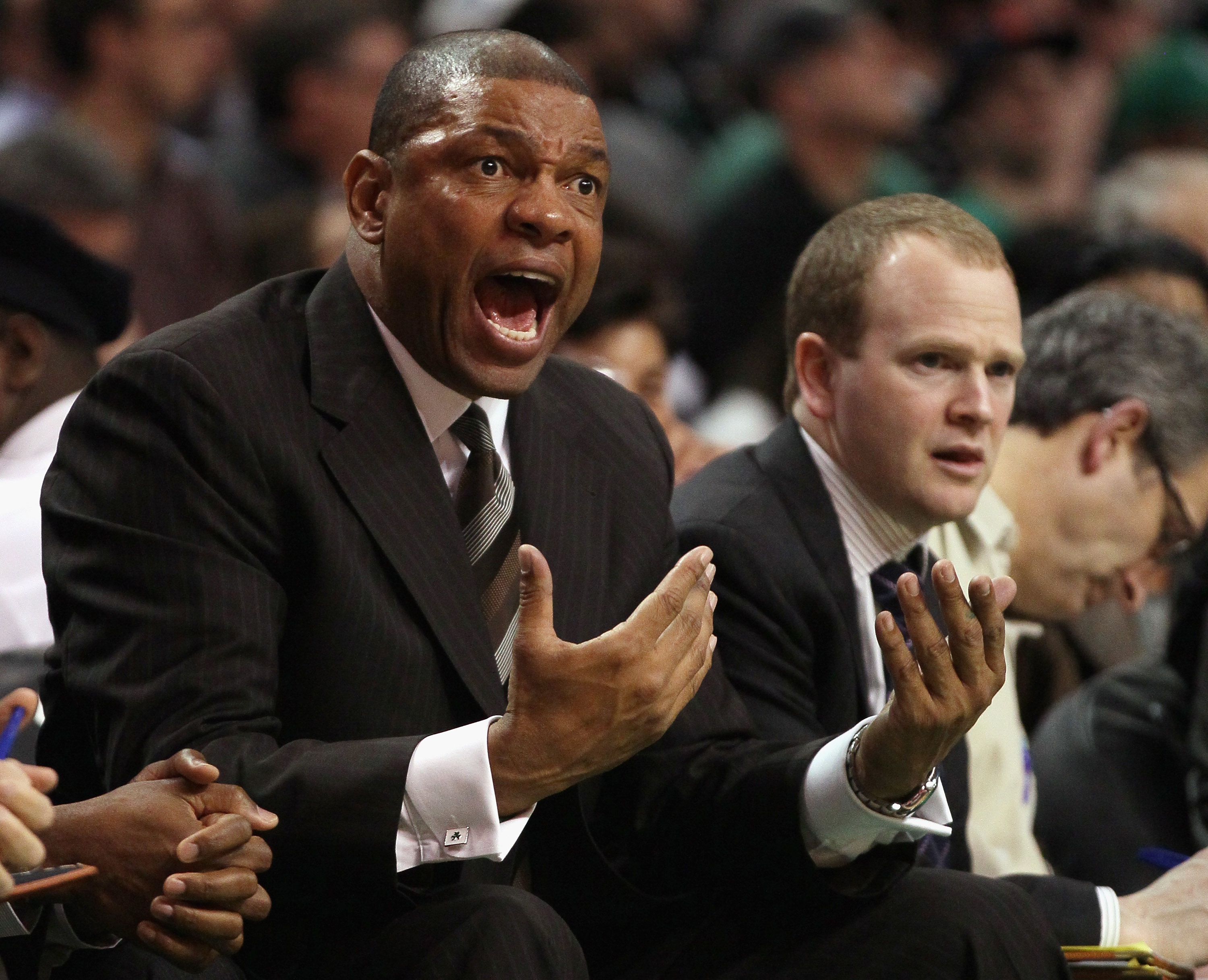 BOSTON, MA - MARCH 09:  Doc Rivers of the Boston Celtics directs his players from the bench in the second half against the Los Angeles Clippers on March 9, 2011 at the TD Garden in Boston, Massachusetts. The Los Angeles Clippers defeated the Boston Celtic
