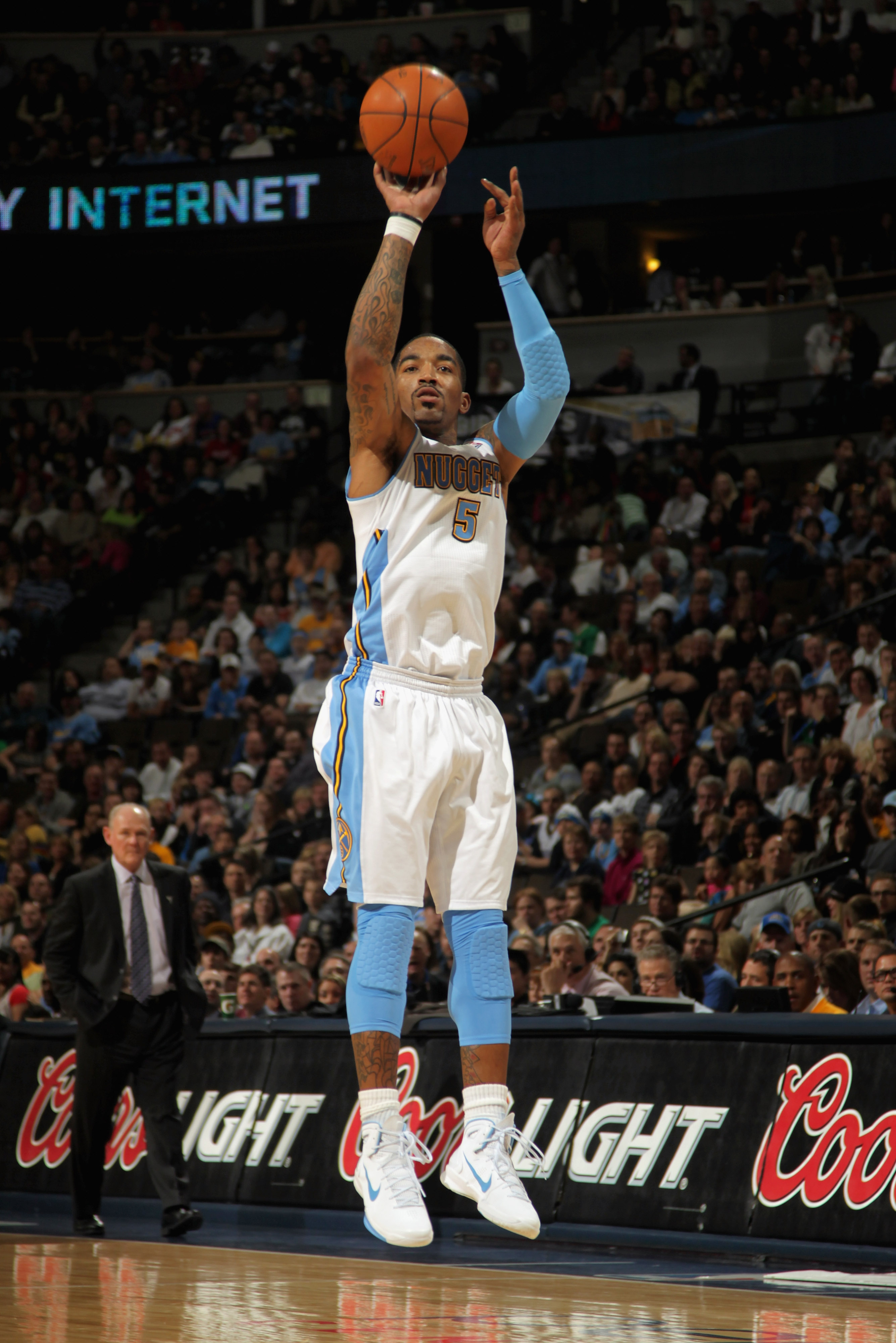 DENVER, CO - MARCH 12:  J.R. Smith #5 of the Denver Nuggets takes a three point shot as he had a game high 31 points agianst the Detroit Pistons as he goes to the basket at the Pepsi Center on March 12, 2011 in Denver, Colorado. The Nuggets defeated the P