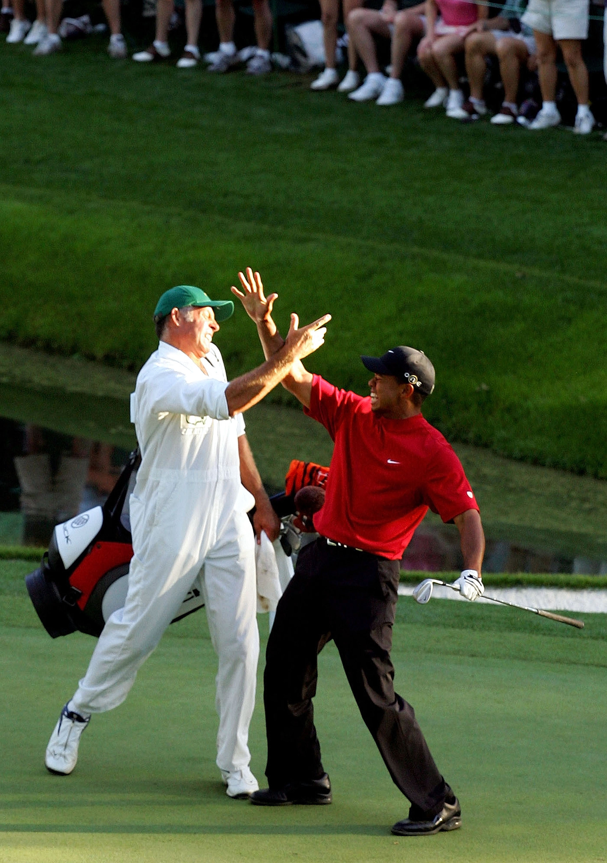 AUGUSTA, GA - APRIL 10:  Tiger Woods and his caddie, Steve Williams, celebrate after Woods chipped in for birdie on the 16th hole during the final round of The Masters at the Augusta National Golf Club on April 10, 2005 in Augusta, Georgia.  (Photo by Har