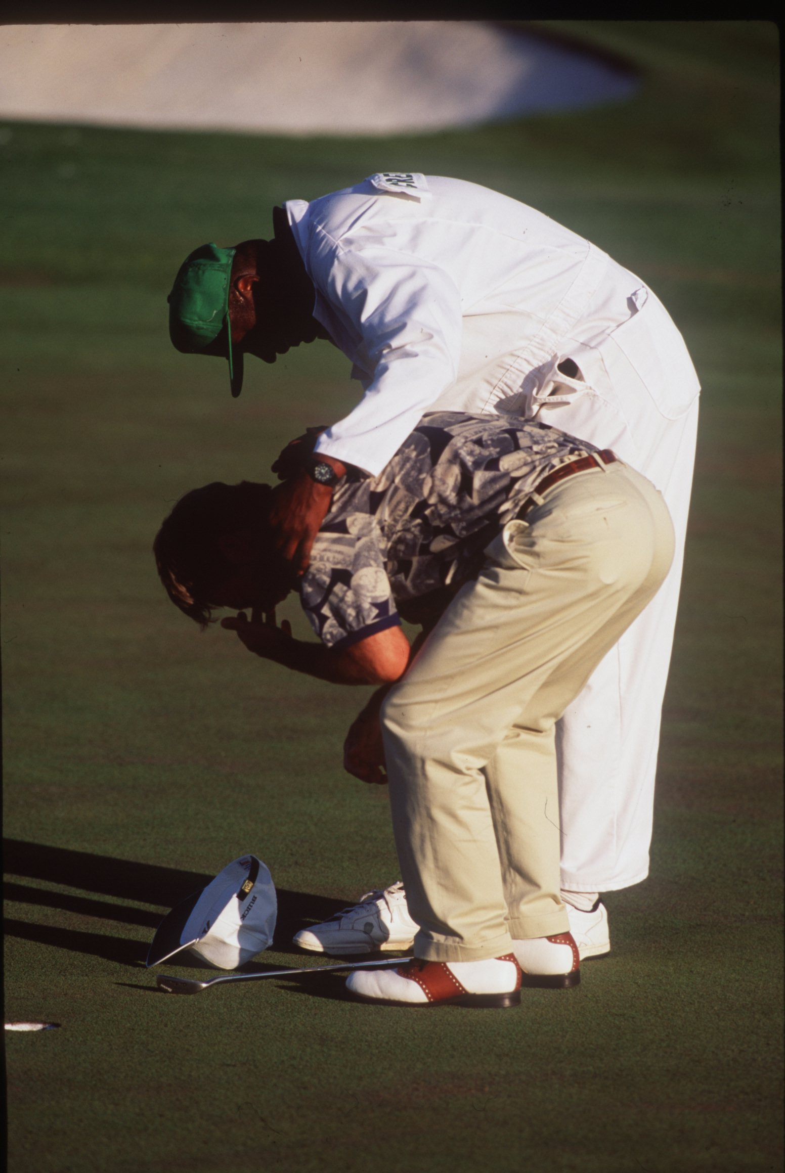 9 APR 1995:  AN EMOTONAL BEN CRENSHAW OF THE USA IS CONGRATULATED BY HIS CADDIE ON THE 18TH GREEN AFTER WINNING THE 1995 US MASTERS GOLF CHAMPIONSHIP AT THE AUGUSTA NATIONAL GOLF COURSE IN AUGUSTA, GEORGIA. Mandatory Credit: Steve Munday/ALLSPORT