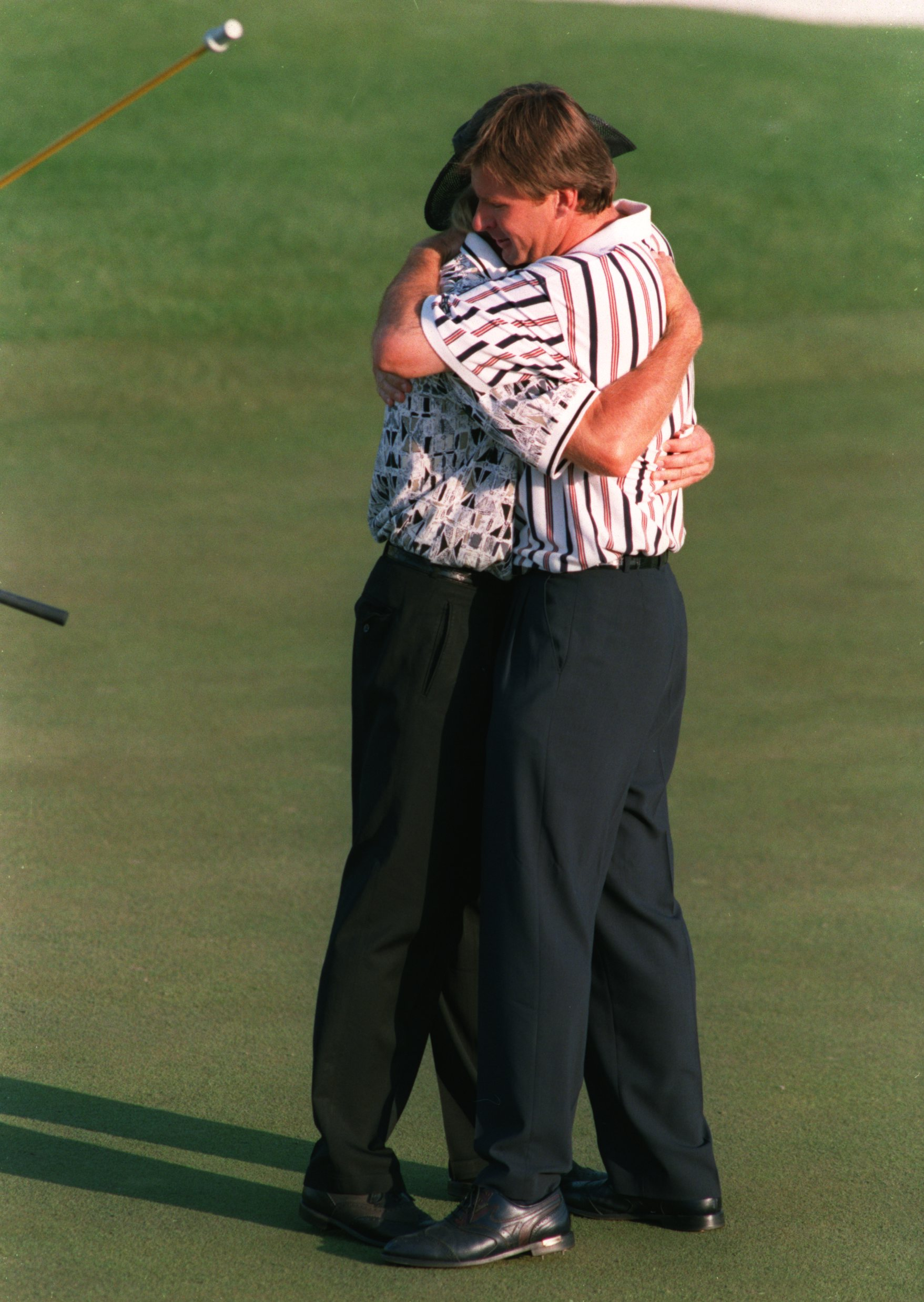 14 Apr 1996 :  Nick Faldo of England is congratulated by runner-up Greg Norman of Australia after holing his final putt on the 18th green for victory in the 1996 US Masters Golf Championship at the Augusta National Golf Club in Augusta, Georgia. Mandatory