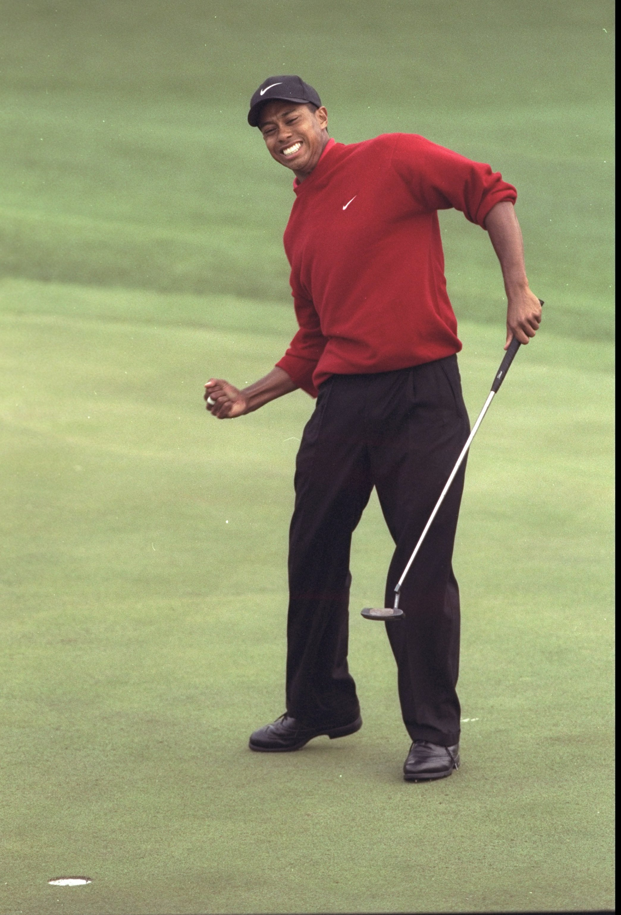 13 Apr 1997: Tiger Woods of the USA celebrates victory in the US Masters at Augusta, Georgia. Woods won the tournament with a record low score of 18 under par. \ Mandatory Credit: David Cannon /Allsport