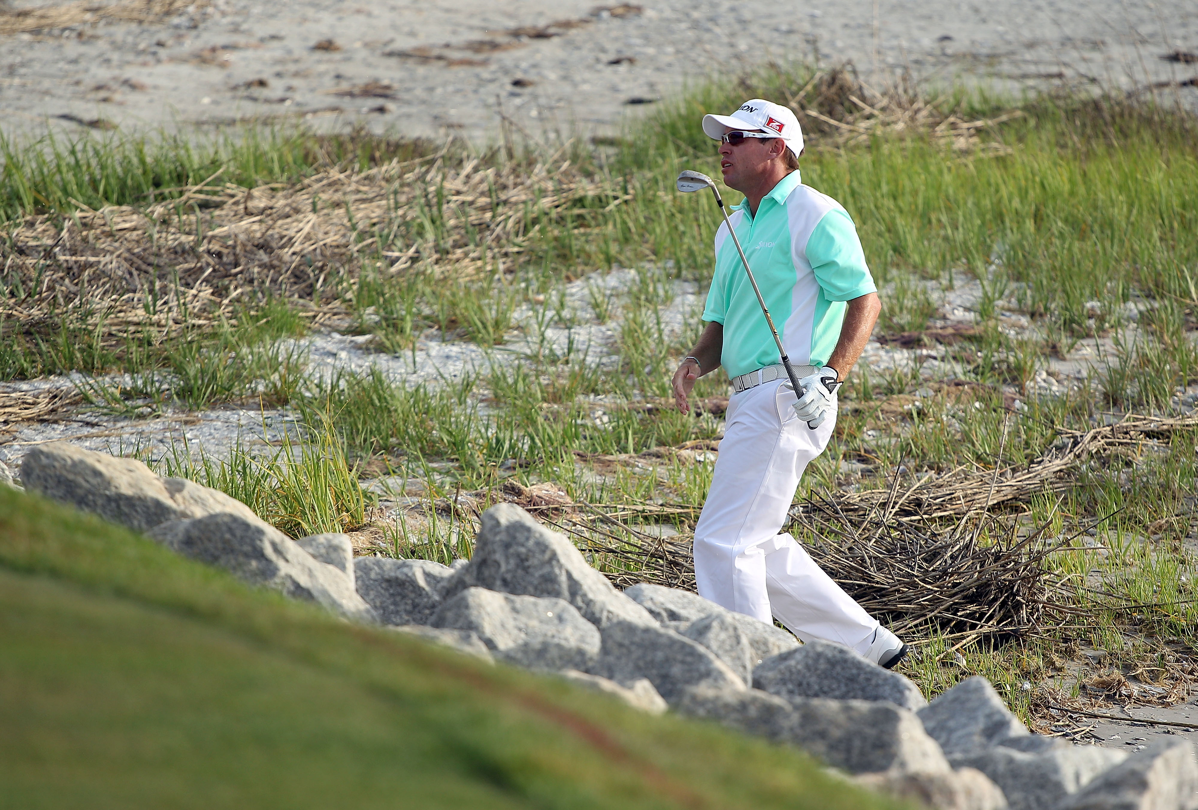 HILTON HEAD ISLAND, SC - APRIL 18:  Brian Davis of England plays a shot from the beach on the first playoff hole during the final round of the Verizon Heritage at the Harbour Town Golf Links on April 18, 2010 in Hilton Head lsland, South Carolina.  (Photo