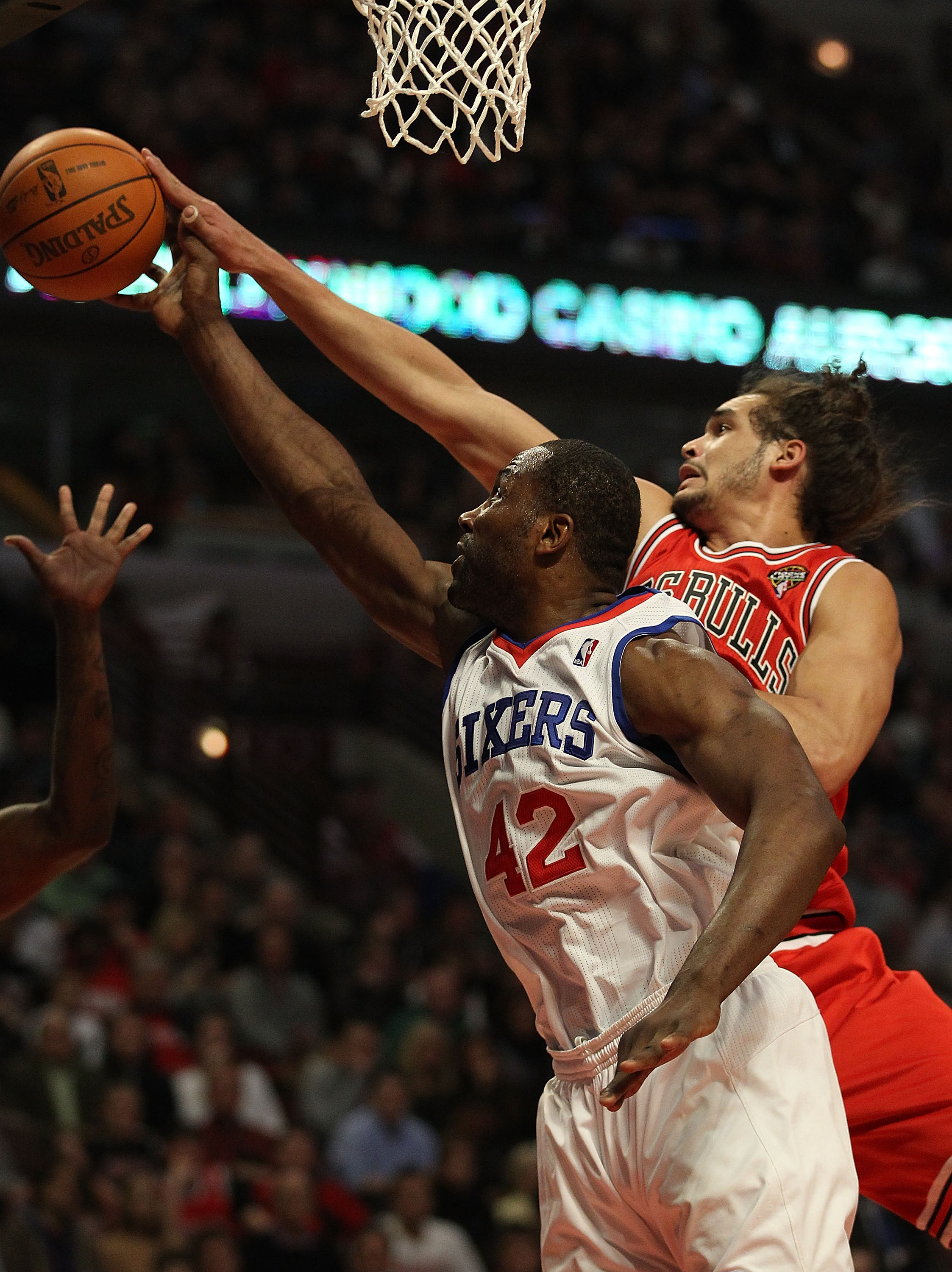 CHICAGO, IL - MARCH 28: Elton Brand #42 of the Philadelphia 76ers and Joakim Noah #13 of the Chicago Bulls reach for a rebound at the United Center on March 28, 2011 in Chicago, Illinois. NOTE TO USER: User expressly acknowledges and agrees that, by downl