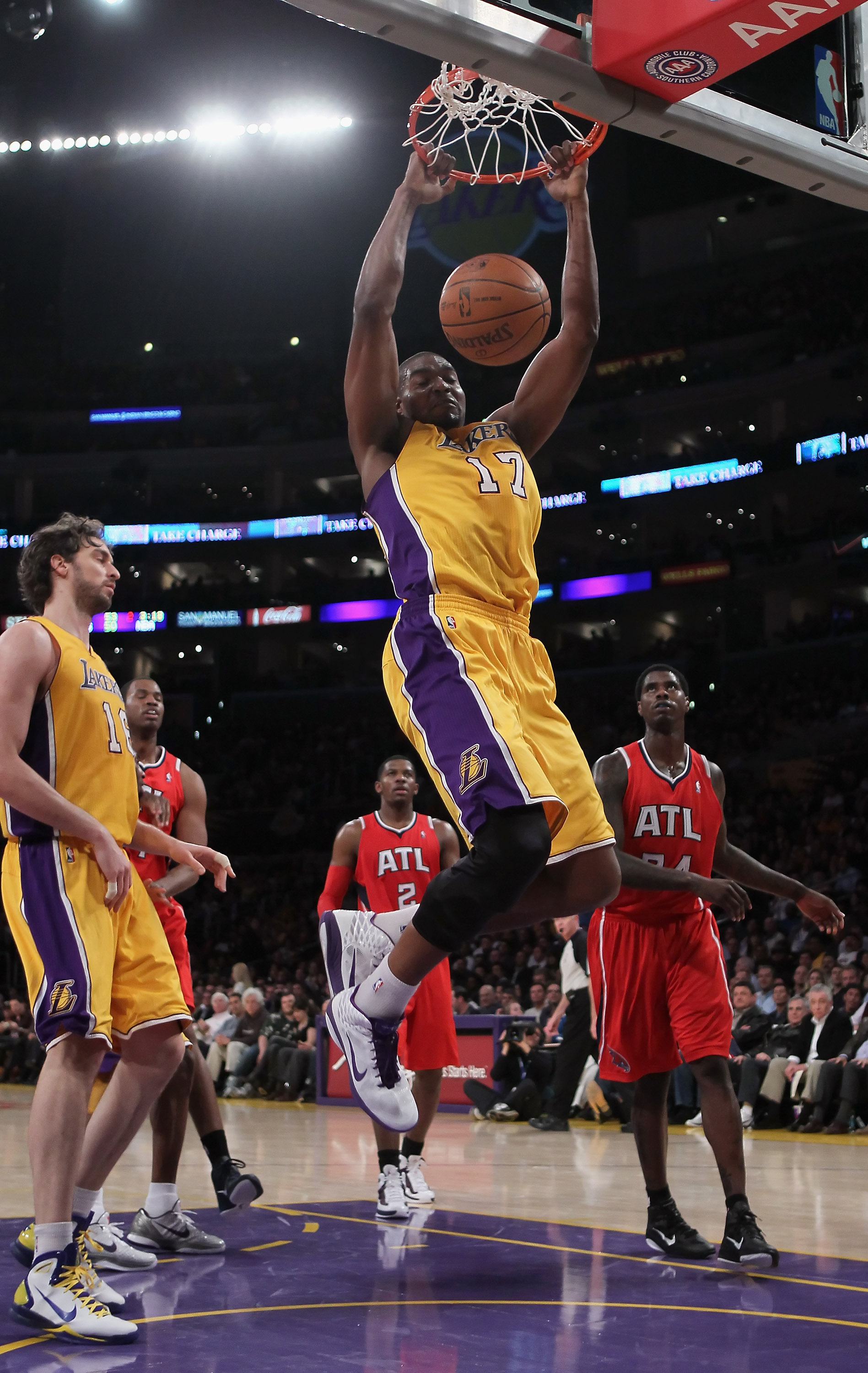 LOS ANGELES, CA - FEBRUARY 22:  Andrew Bynum #17 of the Los Angeles Lakers drives to the basket for a dunk against the Atlanta Hawks in the first half at Staples Center on February 22, 2011 in Los Angeles, California. NOTE TO USER: User expressly acknowle