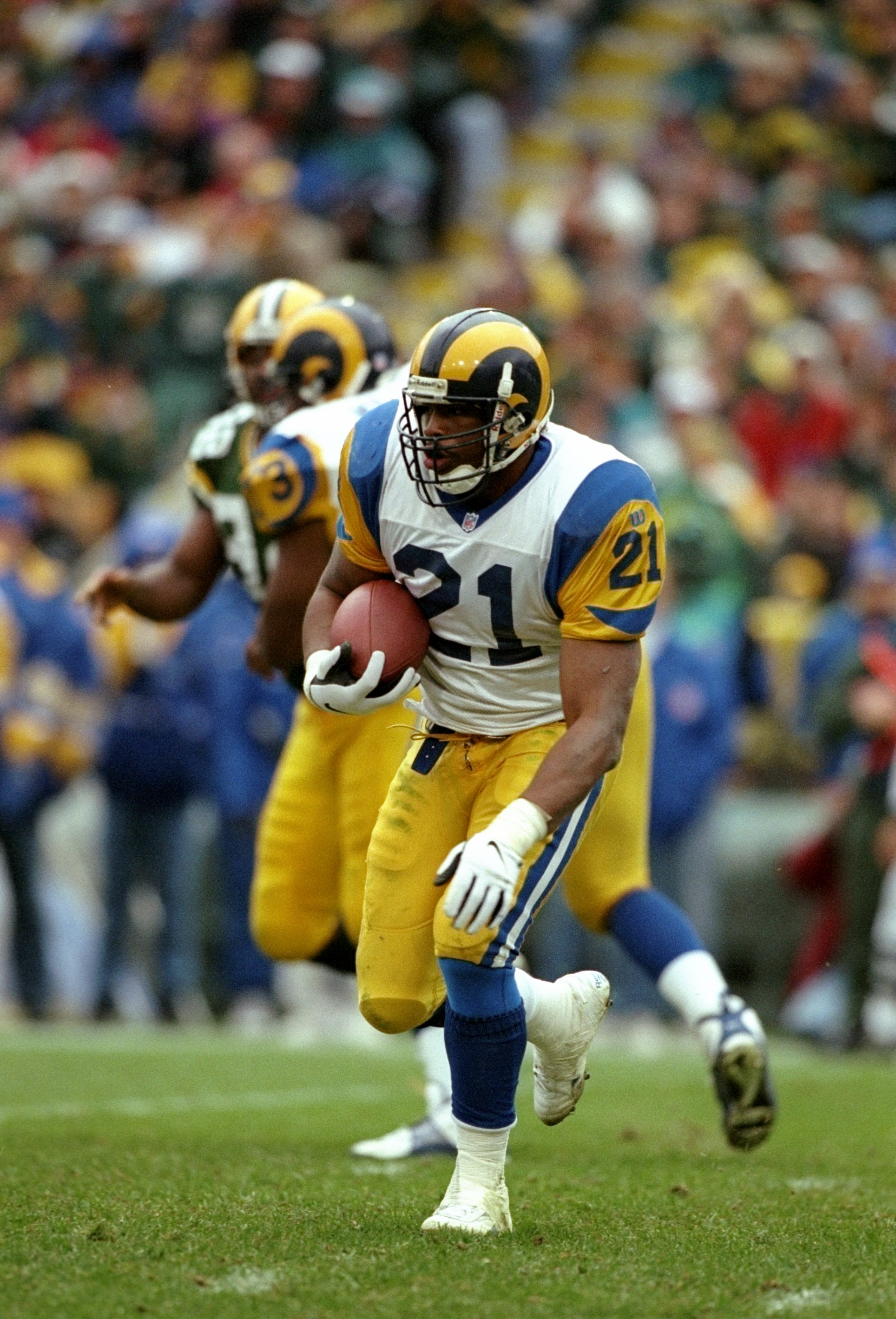 9 Nov 1997:  Running back Lawrence Phillips of the St. Louis Rams runs with the ball during a game against the Green Bay Packers at Lambeau Field in Green Bay, Wisconsin.  The Packers won the game 17-7. Mandatory Credit: Jonathan Daniel  /Allsport