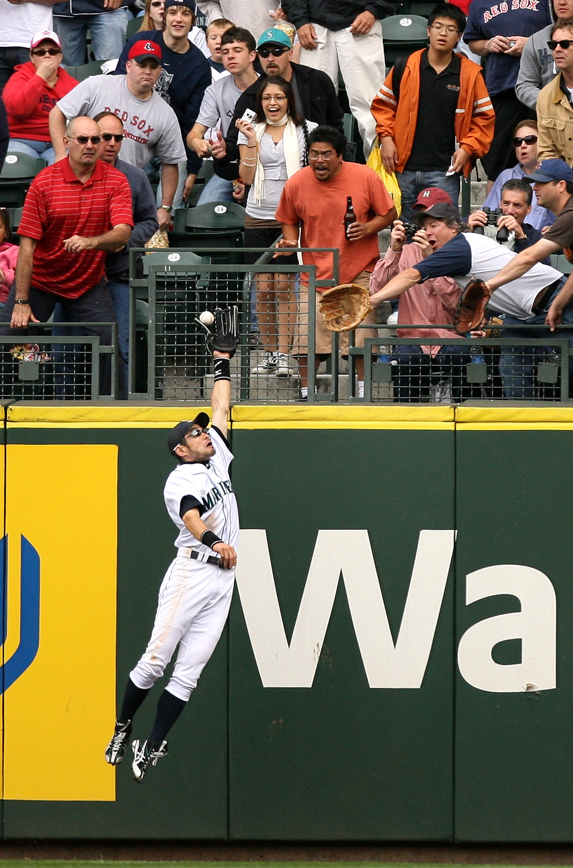 SEATTLE - JULY 23:  Ichiro Suzuki #51 of the Seattle Mariners makes a leaping catch of a ball hit by Dustin Pedroia of the Boston Red Sox on July 23, 2008 at Safeco Field in Seattle, Washington. (Photo by Otto Greule Jr/Getty Images)