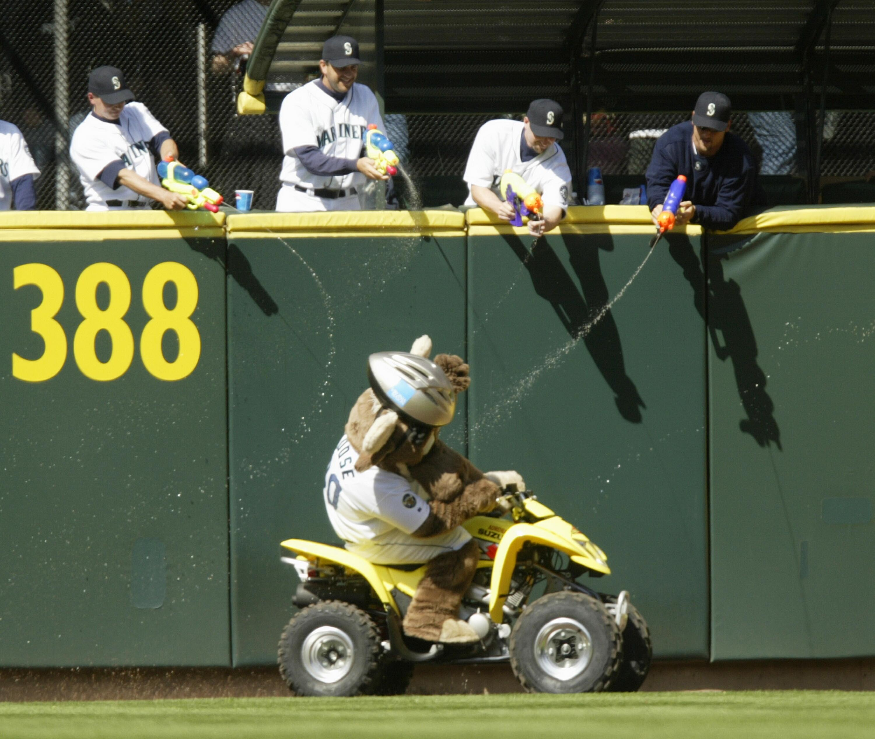 SEATTLE - APRIL 22:  Members of the Seattle Mariners' bullpen, armed with squirt guns, fire upon the team mascot 'Mariner Moose' as he makes his traditional lap around the field during the seventh inning stretch against the Oakland Athletics on April 22,