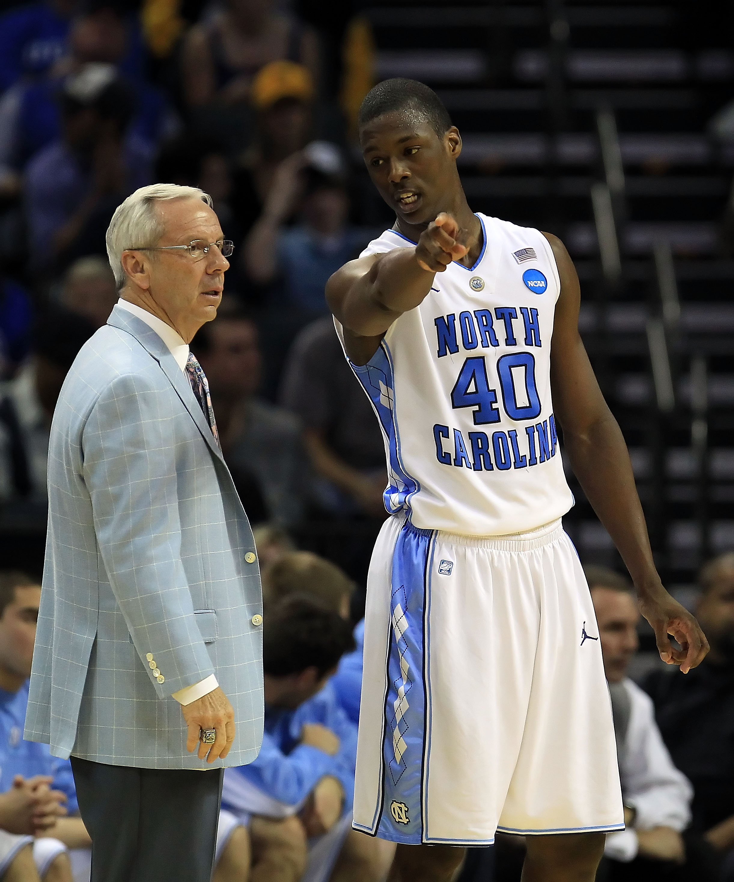 CHARLOTTE, NC - MARCH 20:  Harrison Barnes #40 talks with head coach Roy Williams of the North Carolina Tar Heels while taking on the Washington Huskies during the third round of the 2011 NCAA men's basketball tournament at Time Warner Cable Arena on Marc