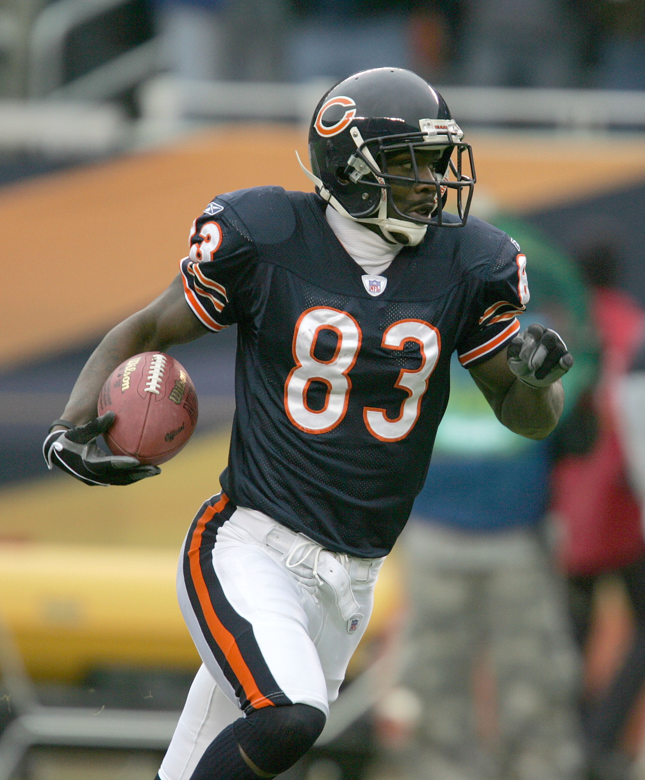 CHICAGO - JANUARY 2: Wide receiver David Terrell #83 of the Chicago Bears takes the ball 63 yards after a reception against the Green Bay Packers on January 2, 2005 at Soldier Field in Chicago, Illinois. (Photo by Jonathan Daniel/Getty Images)