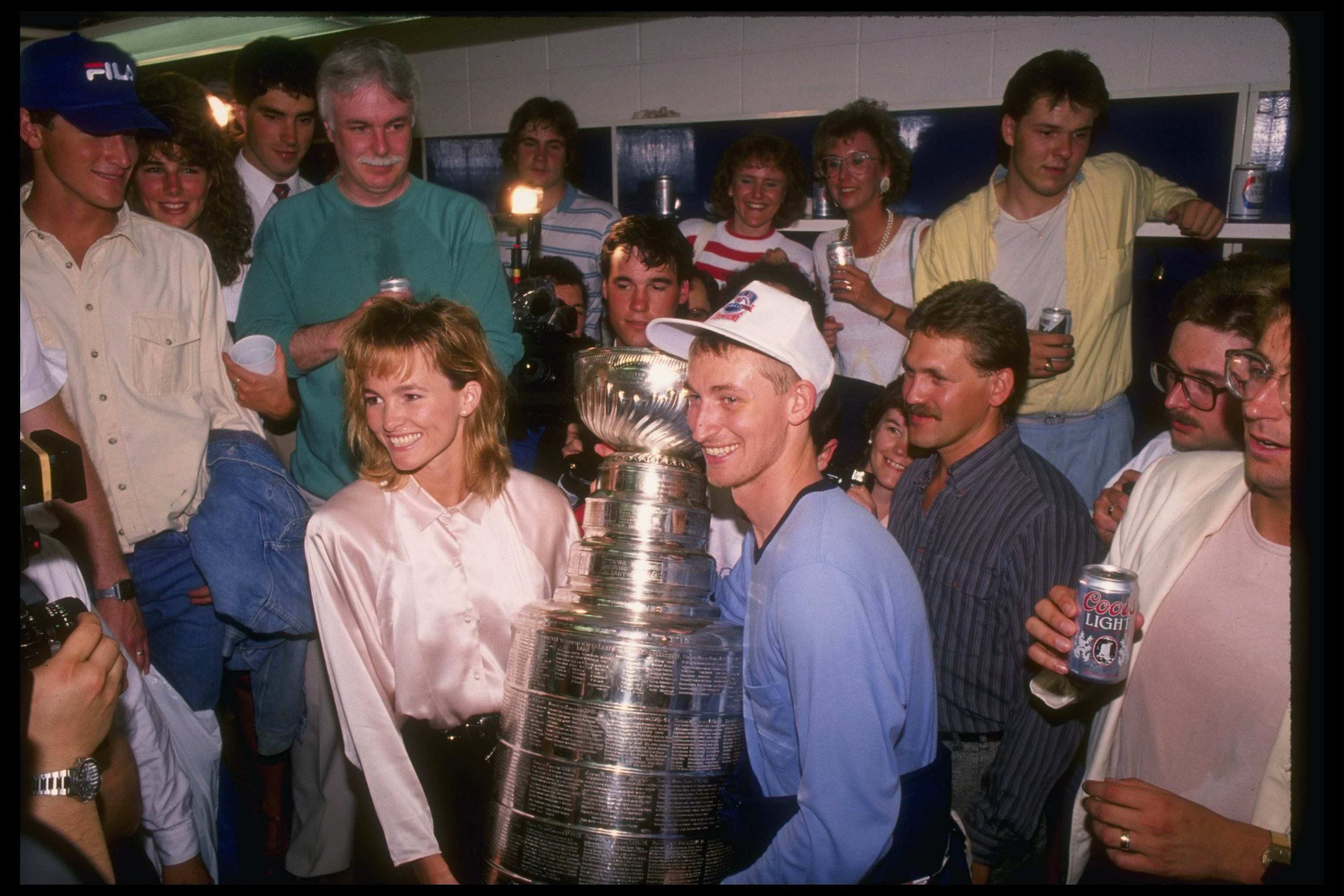 Wayne Gretzky as an Edmonton Oiler, holds the Cup
