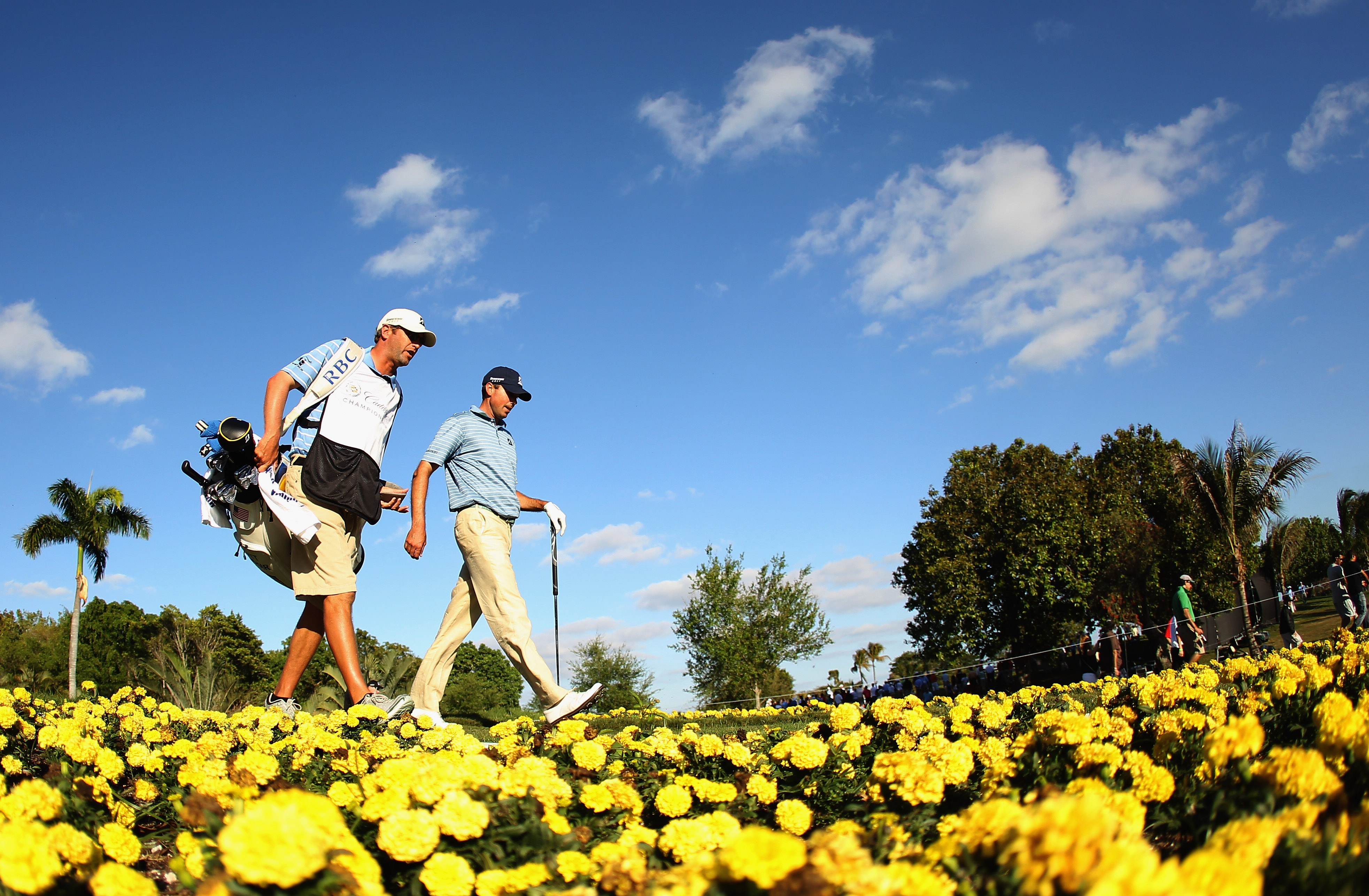 DORAL, FL - MARCH 13:  Matt Kuchar walks off the 15th tee with his caddie Lance Bennett during the final round of the 2011 WGC- Cadillac Championship at the TPC Blue Monster at the Doral Golf Resort and Spa on March 13, 2011 in Doral, Florida.  (Photo by