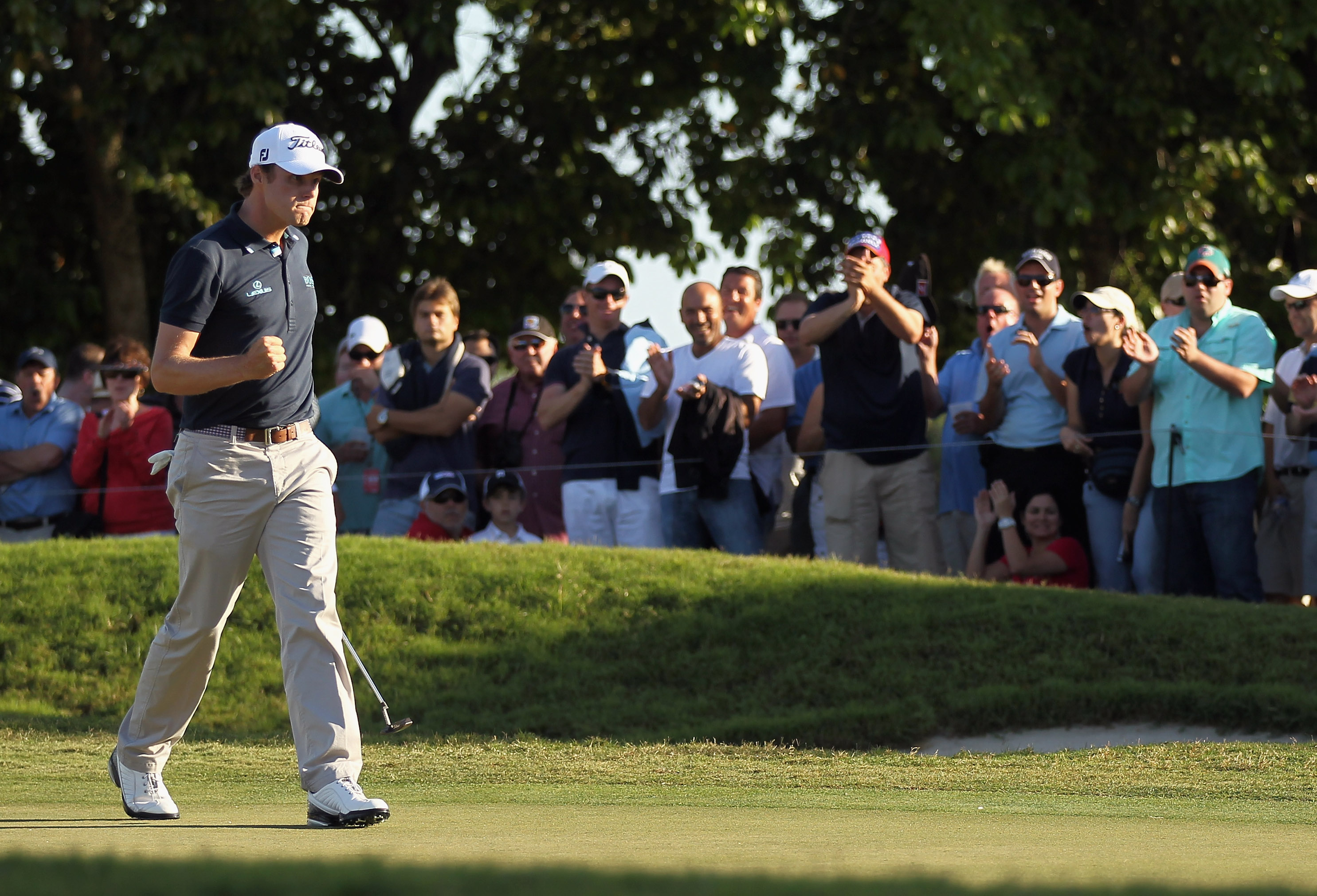 DORAL, FL - MARCH 13:  Nick Watney celebrates his par saving putt on the 15th green during the final round of the 2011 WGC- Cadillac Championship at the TPC Blue Monster at the Doral Golf Resort and Spa on March 13, 2011 in Doral, Florida.  (Photo by Mike