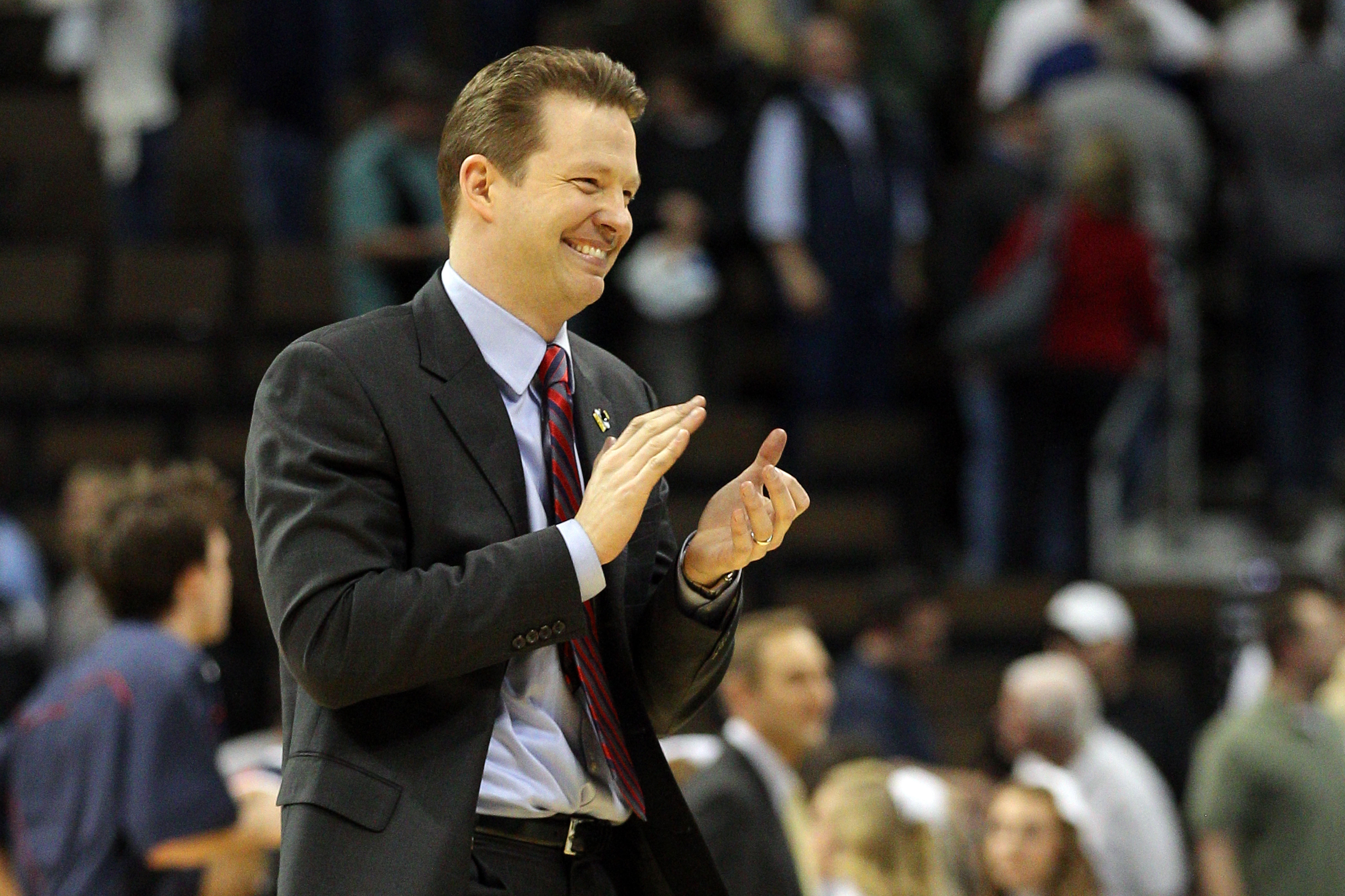 DENVER, CO - MARCH 17:  Head coach Chris Mooney of the Richmond Spiders celebrates after defeating the Vanderbilt Commodores during the second round of the 2011 NCAA men's basketball tournament at Pepsi Center on March 17, 2011 in Denver, Colorado. Richmo