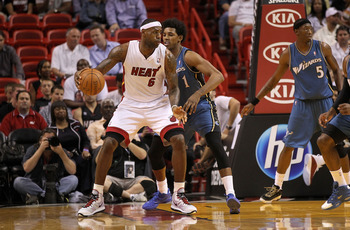 MIAMI, FL - FEBRUARY 25:  LeBron James #6 of the Miami Heat posts up against  Nick Young #1 of the Washington Wizards during a game at American Airlines Arena on February 25, 2011 in Miami, Florida. NOTE TO USER: User expressly acknowledges and agrees tha