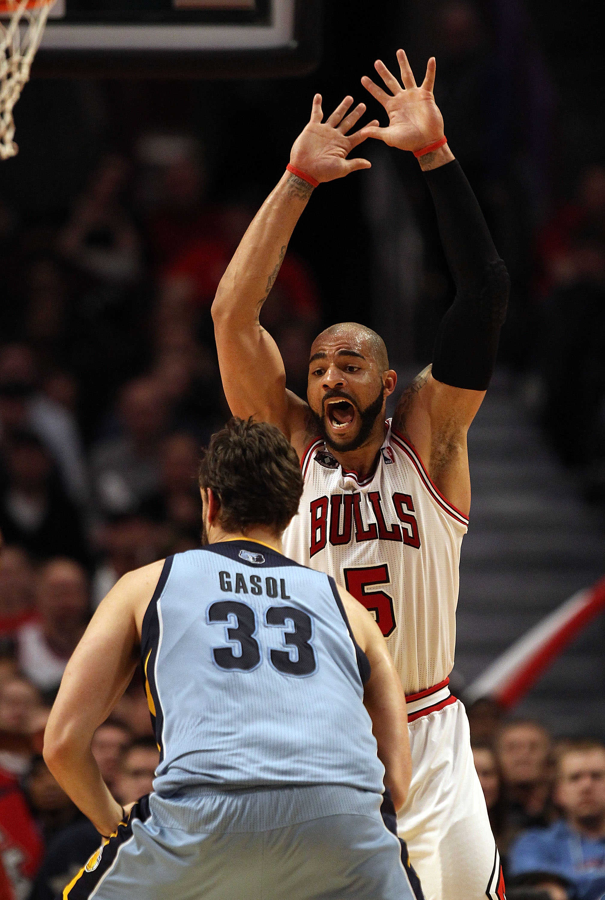CHICAGO, IL - MARCH 25: Carlos Boozer #5 of the Chicago Bulls defends against Marc Gasol #33 of the Memphis Grizzlies at the United Center on March 25, 2011 in Chicago, Illinois. The Bulls defeated the Grizzlies 99-96. NOTE TO USER: User expressly acknowl